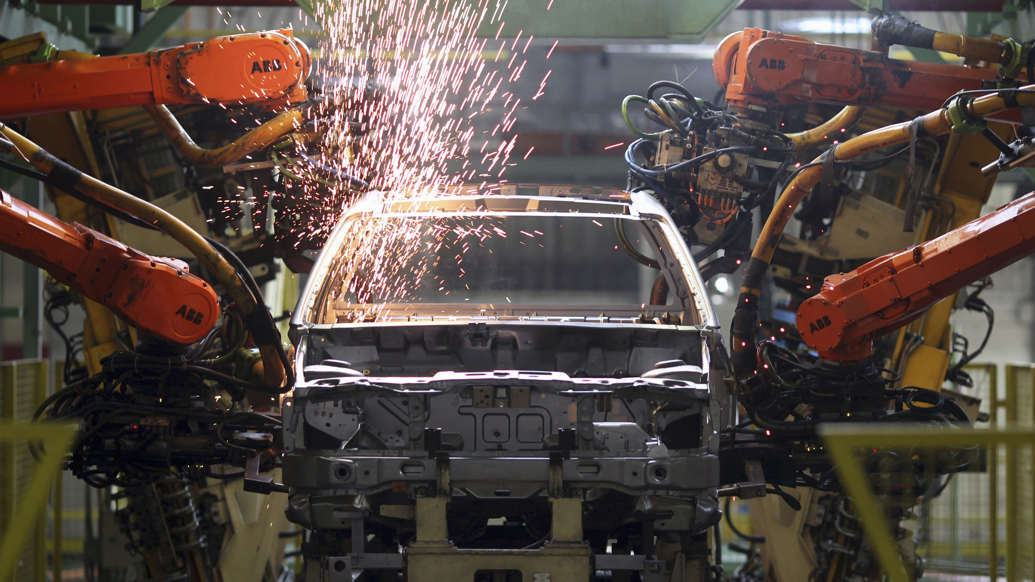 Robots weld cars at the Ford Motor Company's Sao Bernardo do Campo facility in Sao Bernardo do Campo June 14, 2012. Ford Motor Co expects the Brazilian auto market to set a new sales record by the end of the year despite a sluggish start, as recent tax breaks and record-low interest rates jumpstart stagnant business at dealerships. Picture taken June 14, 2012. REUTERS/Paulo Whitaker (BRAZIL - Tags: TRANSPORT BUSINESS)