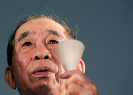 Hong Kong pro-democracy activist Szeto Wah takes part in a candlelight vigil at Hong Kong's Victoria Park, June 4, 2007 to mark the 18th anniversary of the military crackdown on a pro-democracy movement at Beijing's Tiananmen Square in 1989.