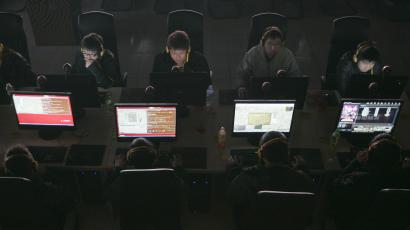 Customers use computers at an internet cafe in Taiyuan, Shanxi province March 10, 2010.