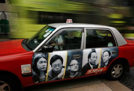 Portraits of resigned pro-democracy lawmakers (L-R) Leung Kwok-hung, Raymond Wong, Albert Chan, Alan Leong and Tanya Chan are printed on a taxi as an advertistment ahead of a by-election in Hong Kong May 5, 2010. Five Hong Kong lawmakers resigned from the legislature in late January in a bid to pressure China to grant the former British colony greater and swifter democratic concessions. The by-election on May 16 is being seen as a de facto referendum on full democracy in the territory.