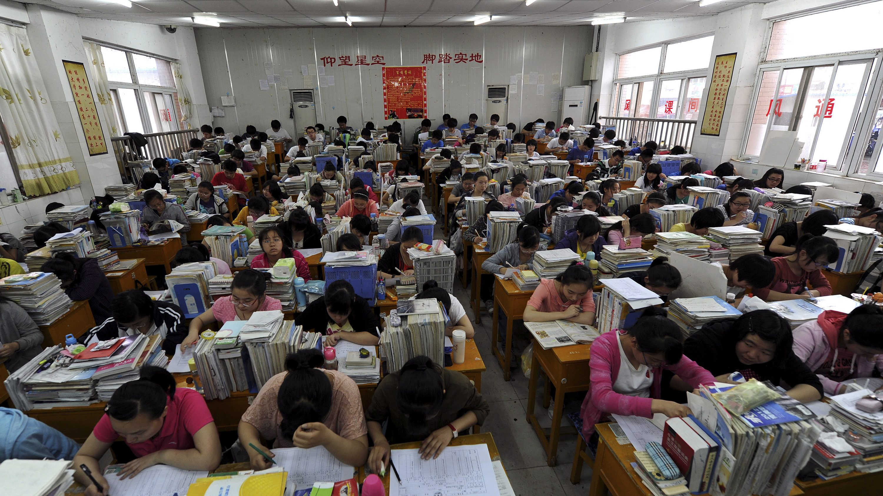 "Students prepare for the university entrance exam in a classroom in Hefei, Anhui Province June 2, 2012. The National College Entrance Exam, or ""Gaokao"", is held in June every year. Picture taken June 2, 2012."
