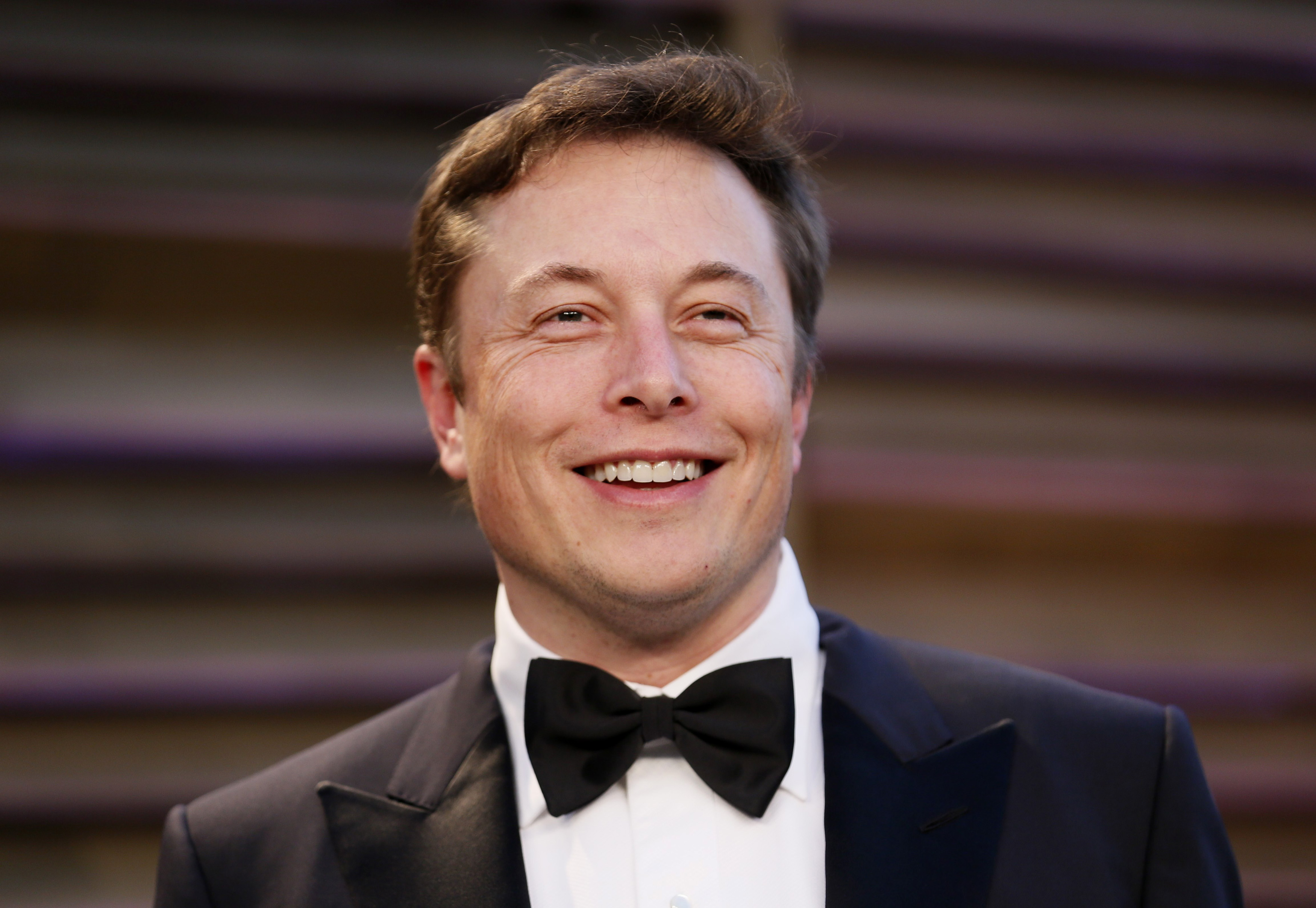 Chief Executive of SpaceX and Tesla Motors Elon Musk arrives at the 2014 Vanity Fair Oscars Party in West Hollywood, California March 2, 2014.  REUTERS/Danny Moloshok (UNITED STATES  - Tags: ENTERTAINMENT BUSINESS HEADSHOT)(OSCARS-PARTIES) - RTR3FY5U