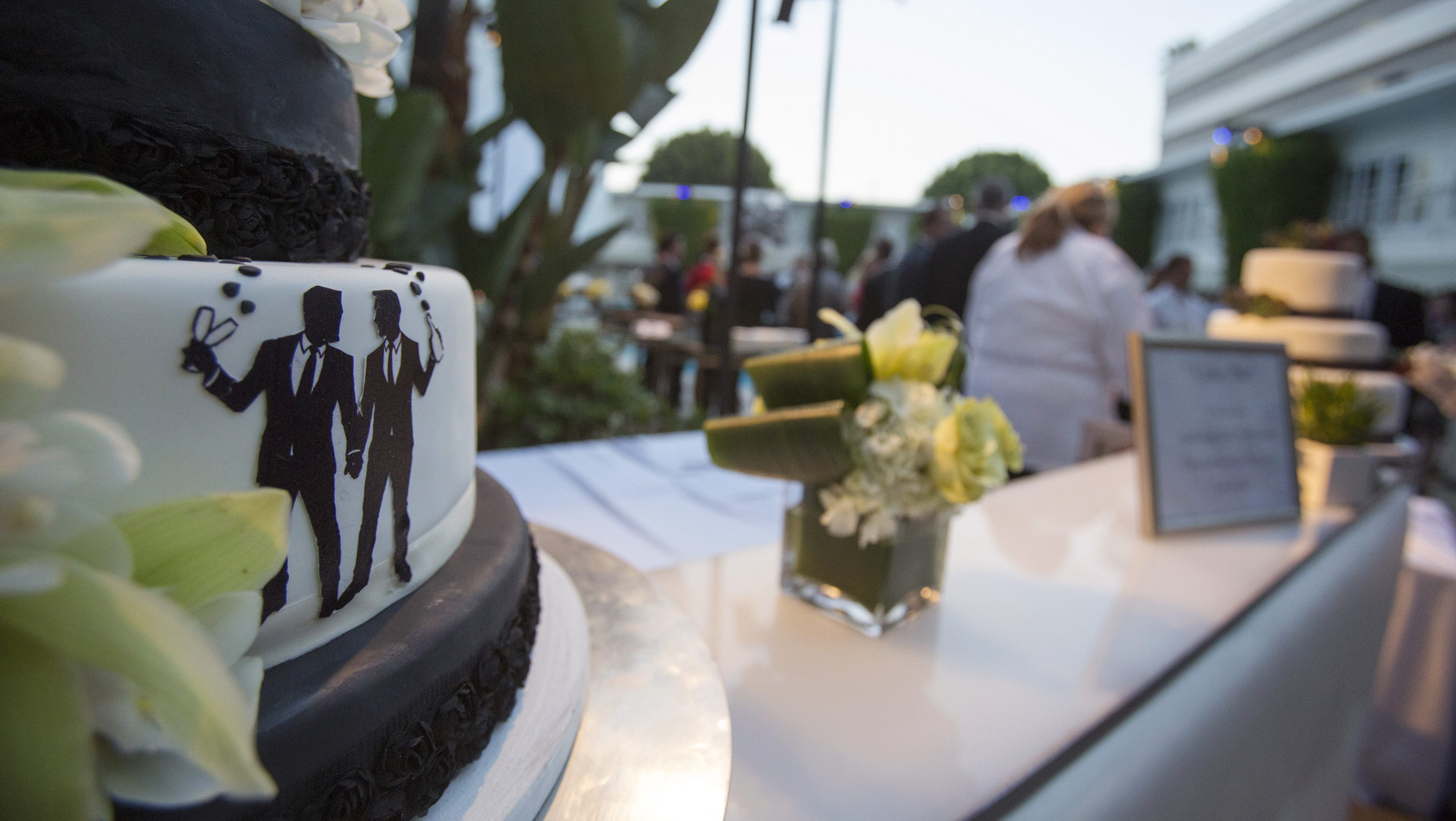 Groom figurines are seen on a cake at a ceremony to celebrate the wedding of Jeff Zarrillo and Paul Katami at Beverly Hilton Hotel in Beverly Hills, California June 28, 2014. A year after becoming among the first same-sex couples to wed legally in California, the two men who were plaintiffs in the case that led to a court overturning the state's five-year ban on gay marriage held a lavish ceremony on Saturday with family and friends including Hollywood stars to celebrate their wedding.  REUTERS/Mario Anzuoni  (UNITED STATES - Tags: SOCIETY ENTERTAINMENT POLITICS) - RTR3W9GU