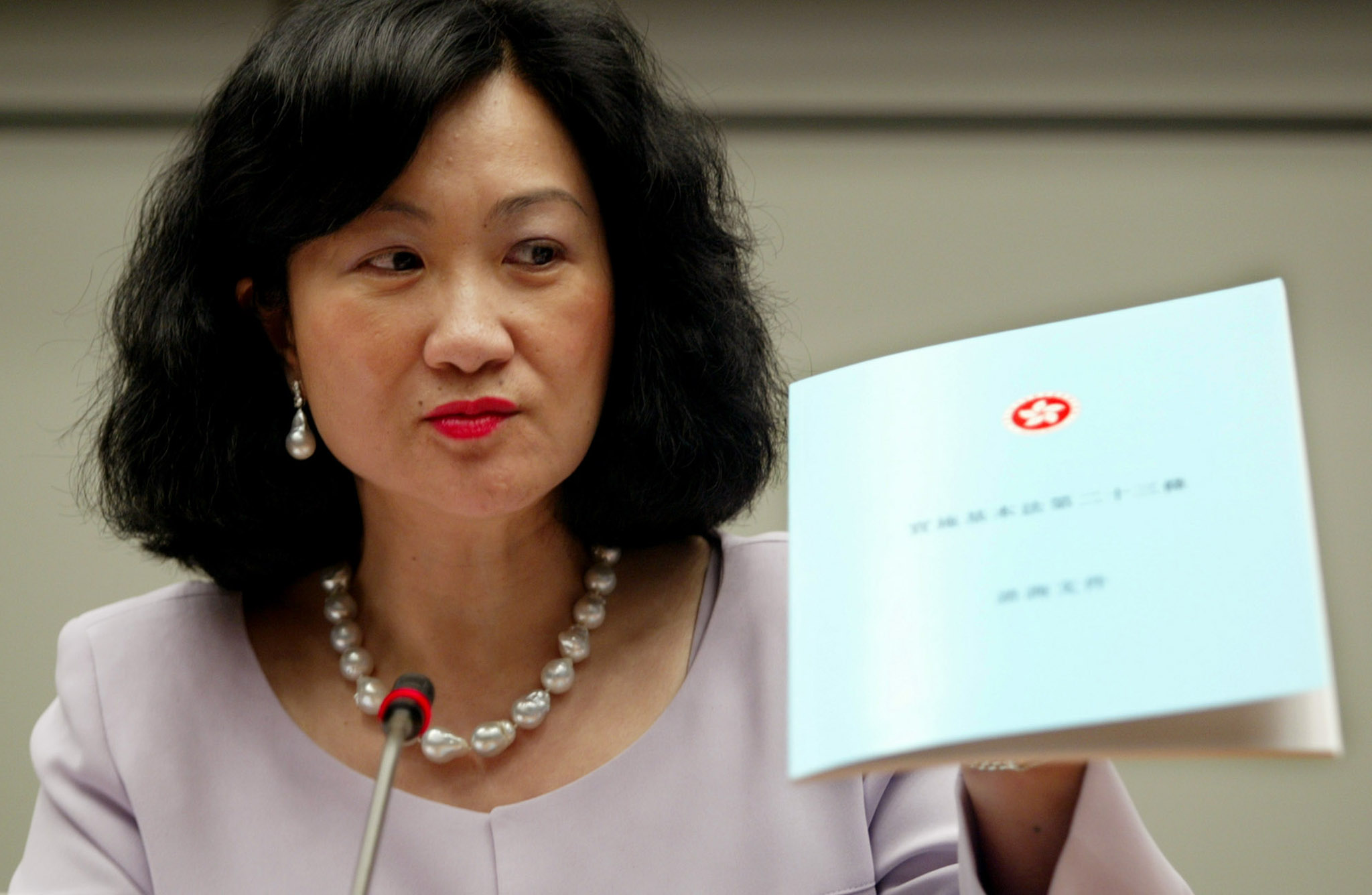 Hong Kong's Secretary for Security Regina Ip holds a consultation document on a planned anti-subversion law during a news conference in Hong Kong September 24, 2002. The territory unveiled the proposals on Tuesday that rights groups fear could pose the most serious threat to civil liberties since this former British colony returned to Chinese rule.