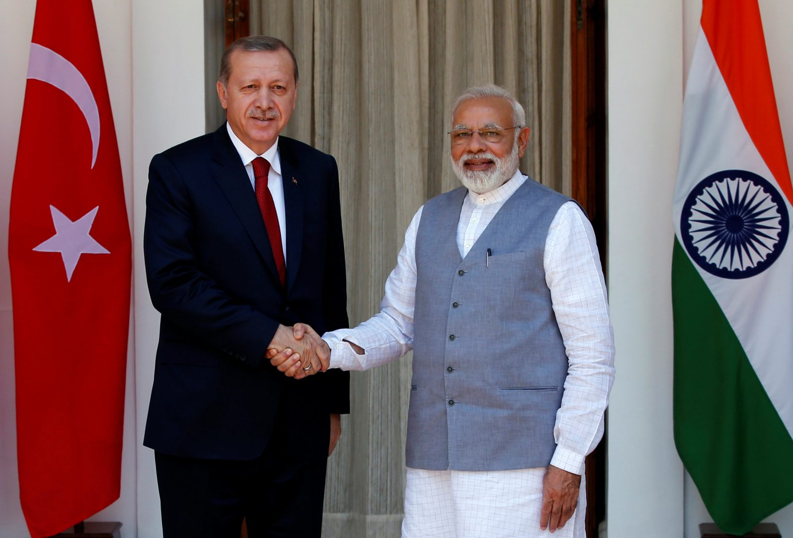 Turkish President Tayyip Erdogan (L) shakes hands with India's Prime Minister Narendra Modi during a photo opportunity ahead of their meeting at Hyderabad House in New Delhi, India, May 1, 2017.