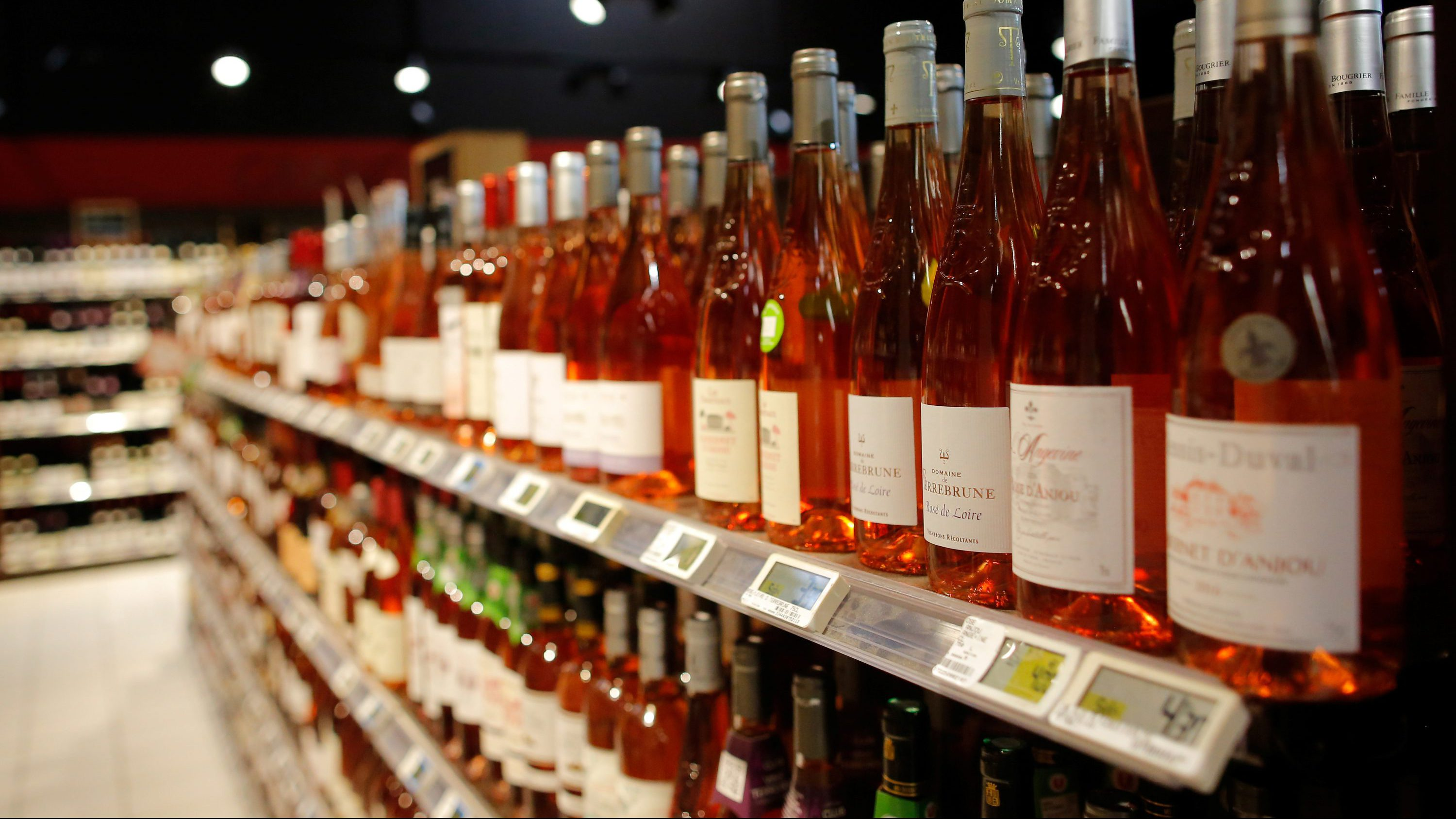 Bottles of rose wine are displayed for sale in a supermarket in Vertou, near Nantes, France, June 20, 2017.