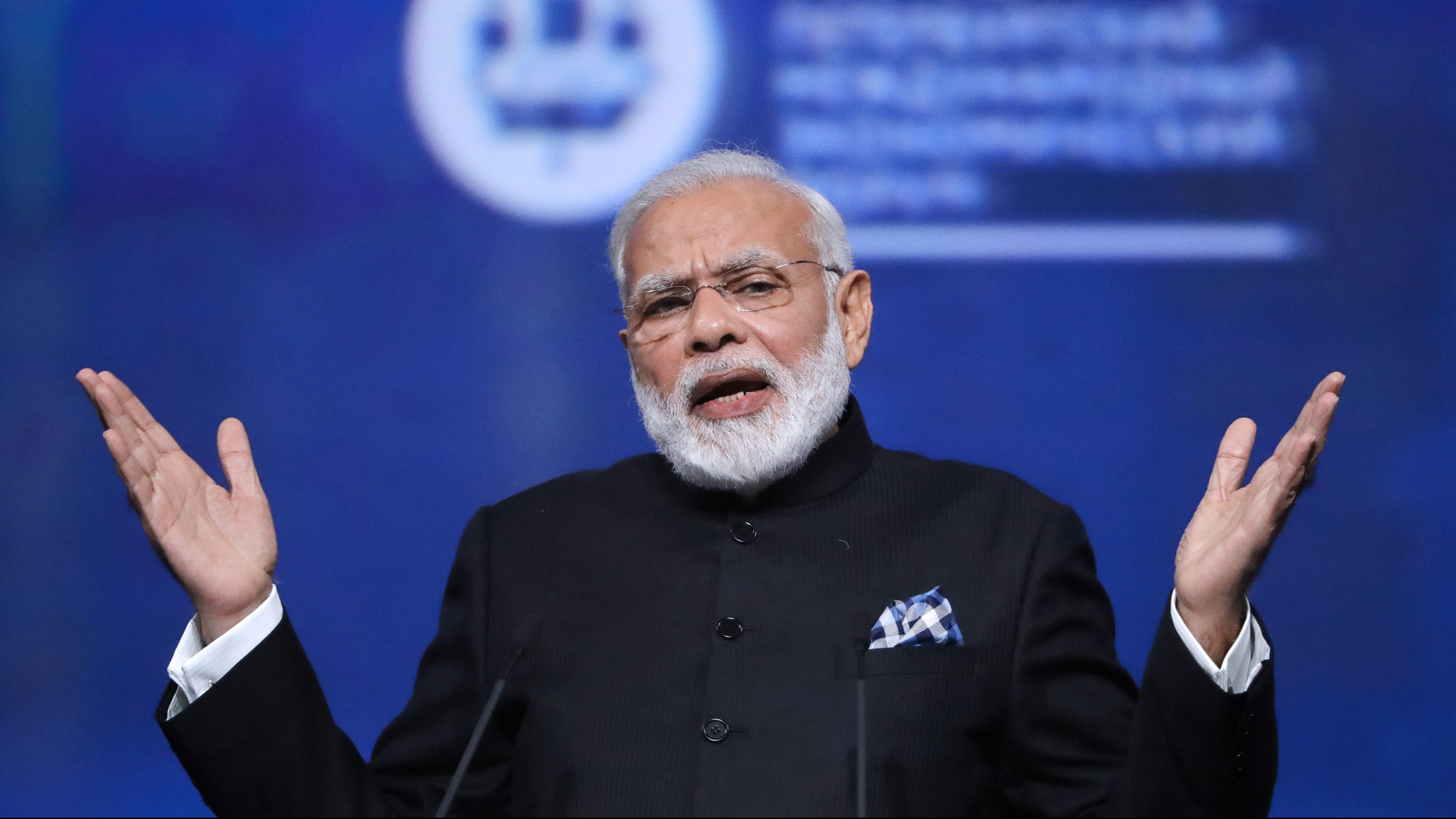 FILE PHOTO: Indian Prime Minister Narendra Modi gestures during a session of the St. Petersburg International Economic Forum (SPIEF), Russia, June 2, 2017.  - RTS18L9O