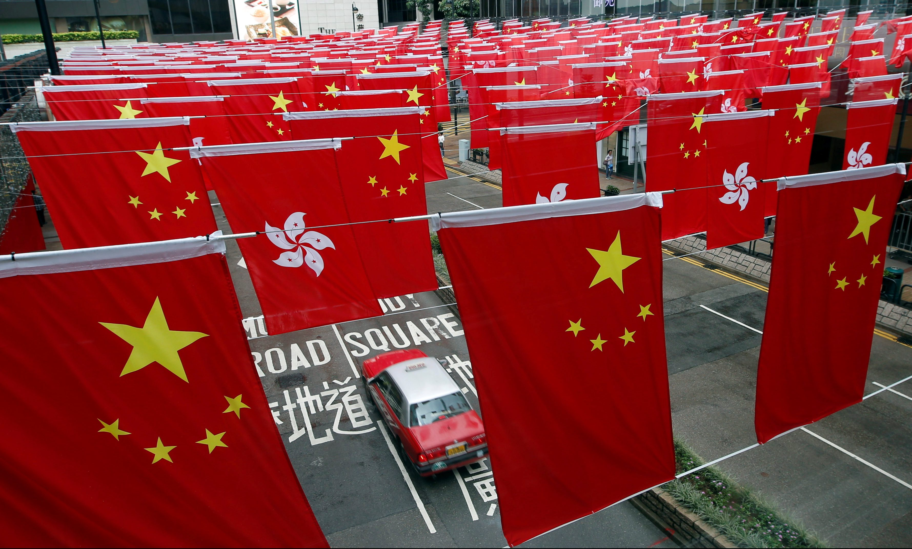 Chinese and Hong Kong flags are seen after celebrations commemorating the 20th anniversary of Hong Kong's handover to Chinese sovereignty from British rule, in Hong Kong