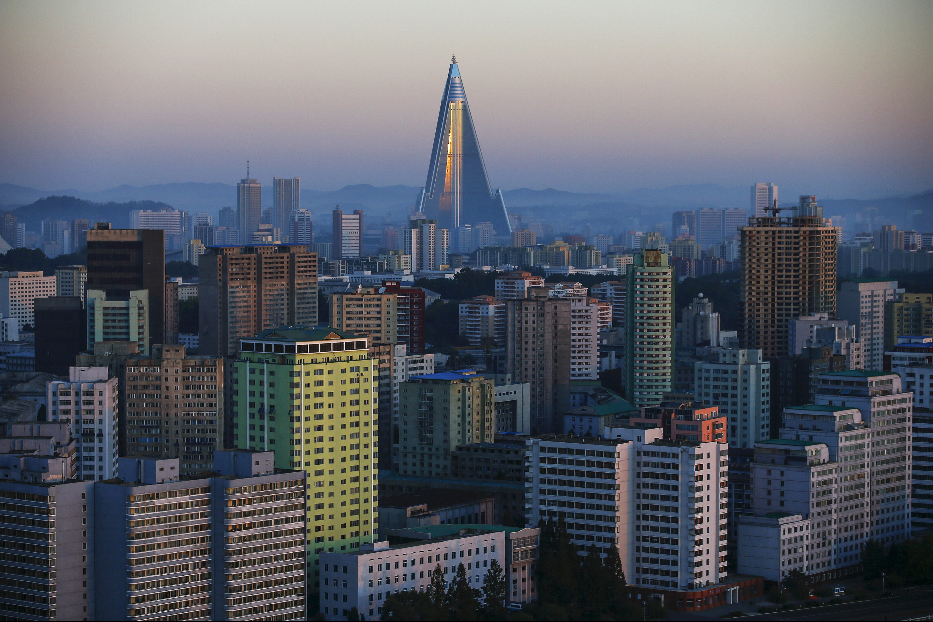 The 105-storey Ryugyong Hotel, the highest building under construction in North Korea, is seen behind residential buildings in Pyongyang, North Korea, early October 9, 2015. North Korea is getting ready to celebrate the 70th anniversary of the founding of its ruling Workers' Party of Korea on October 10.