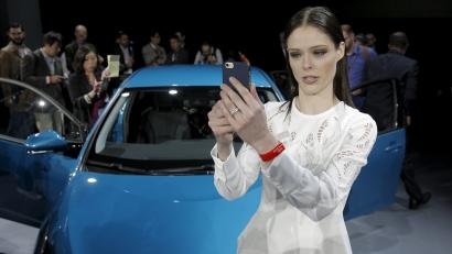 Model Coco Rocha takes a selfie in front of the Toyota Prius Prime during the media preview of the 2016 New York International Auto Show in Manhattan, New York March 23, 2016. REUTERS/Brendan McDermid - RTSBX8C