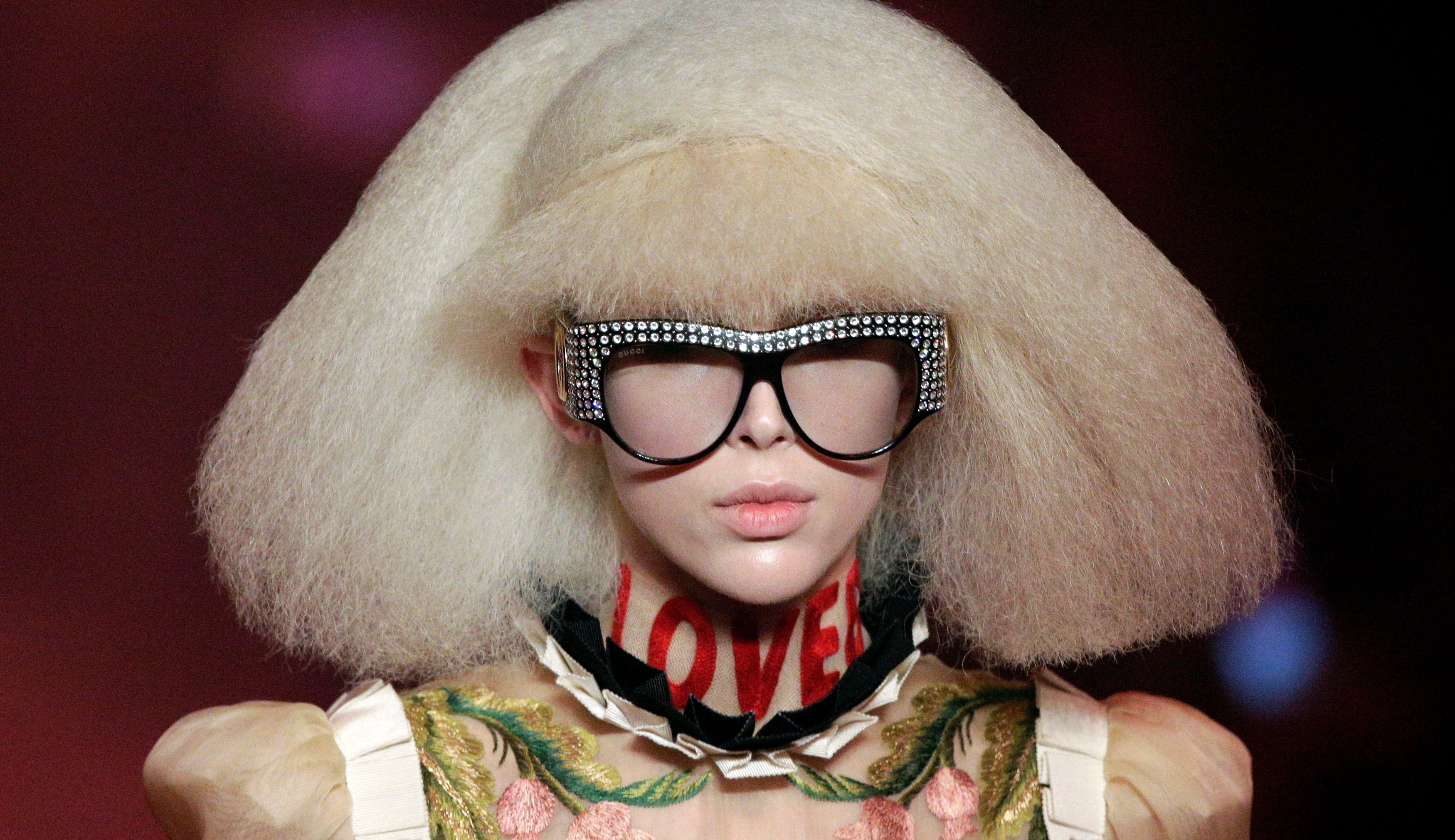 ec1fdcb44b1 A model presents a creation at the Gucci fashion show during Milan Fashion  Week Spring