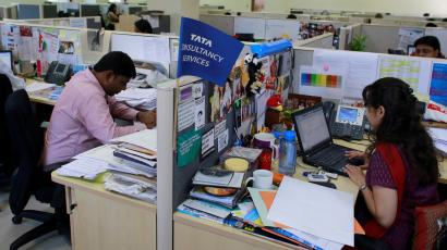 Employees of Tata Consultancy Services (TCS) work inside the company headquarters in Mumbai