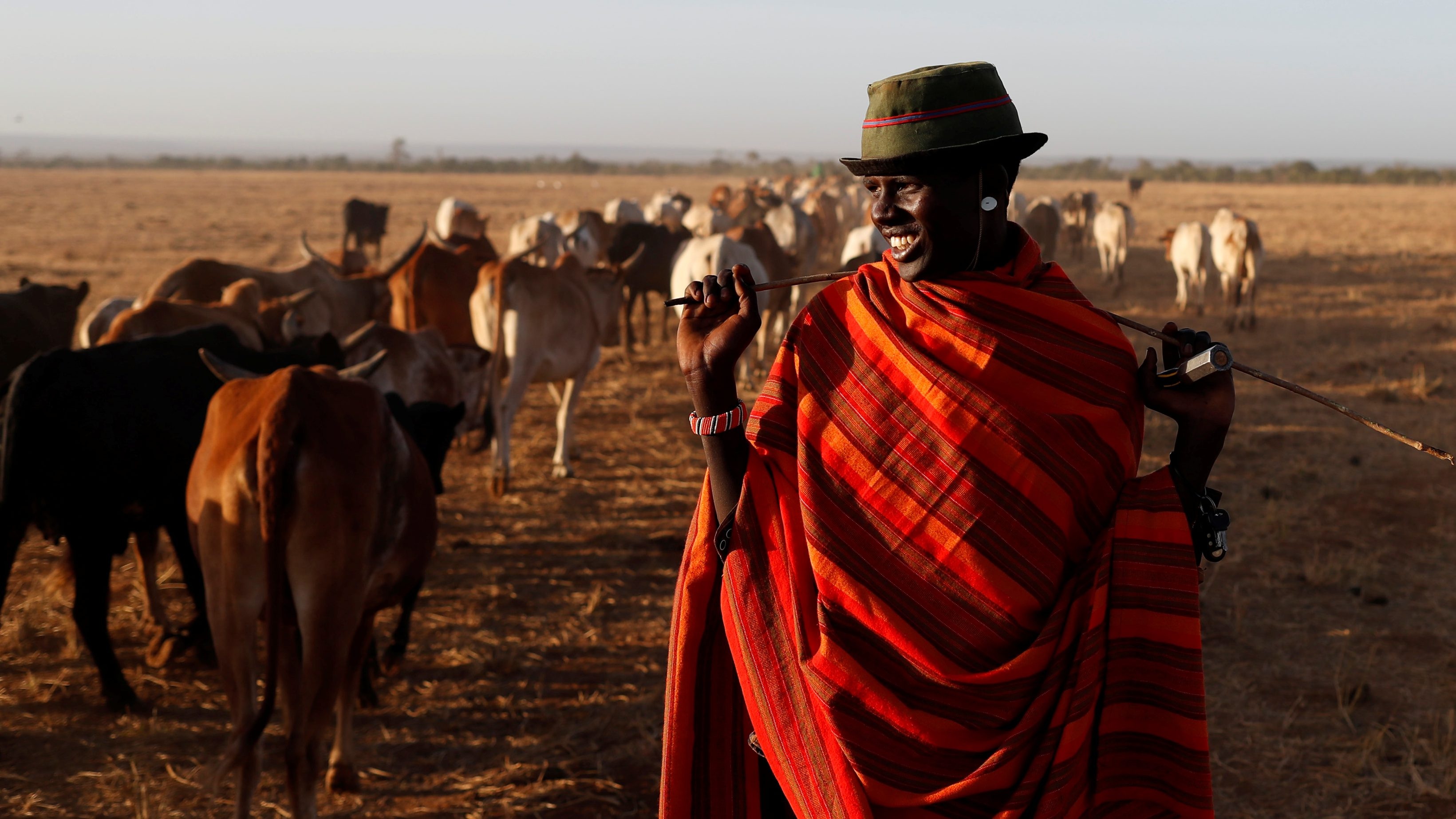 A Samburu tribesman stands behind cows as he enters the Mugui conservancy, Kenya February 11, 2017.