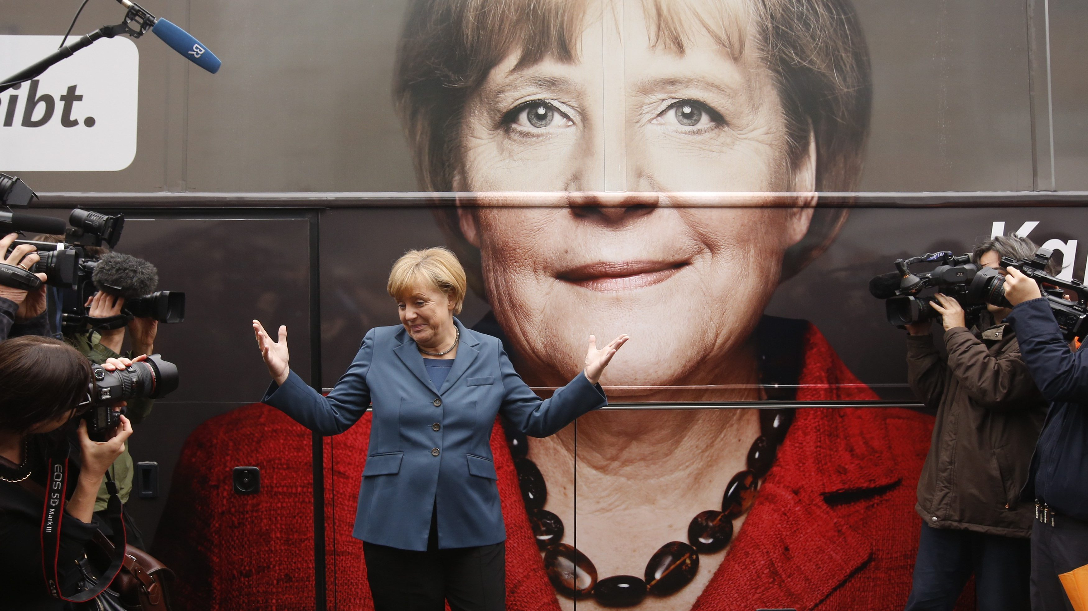 German Chancellor Merkel and leader of the CDU party stands in front of her election campaign tour bus at the CDU's headquarters in Berlin