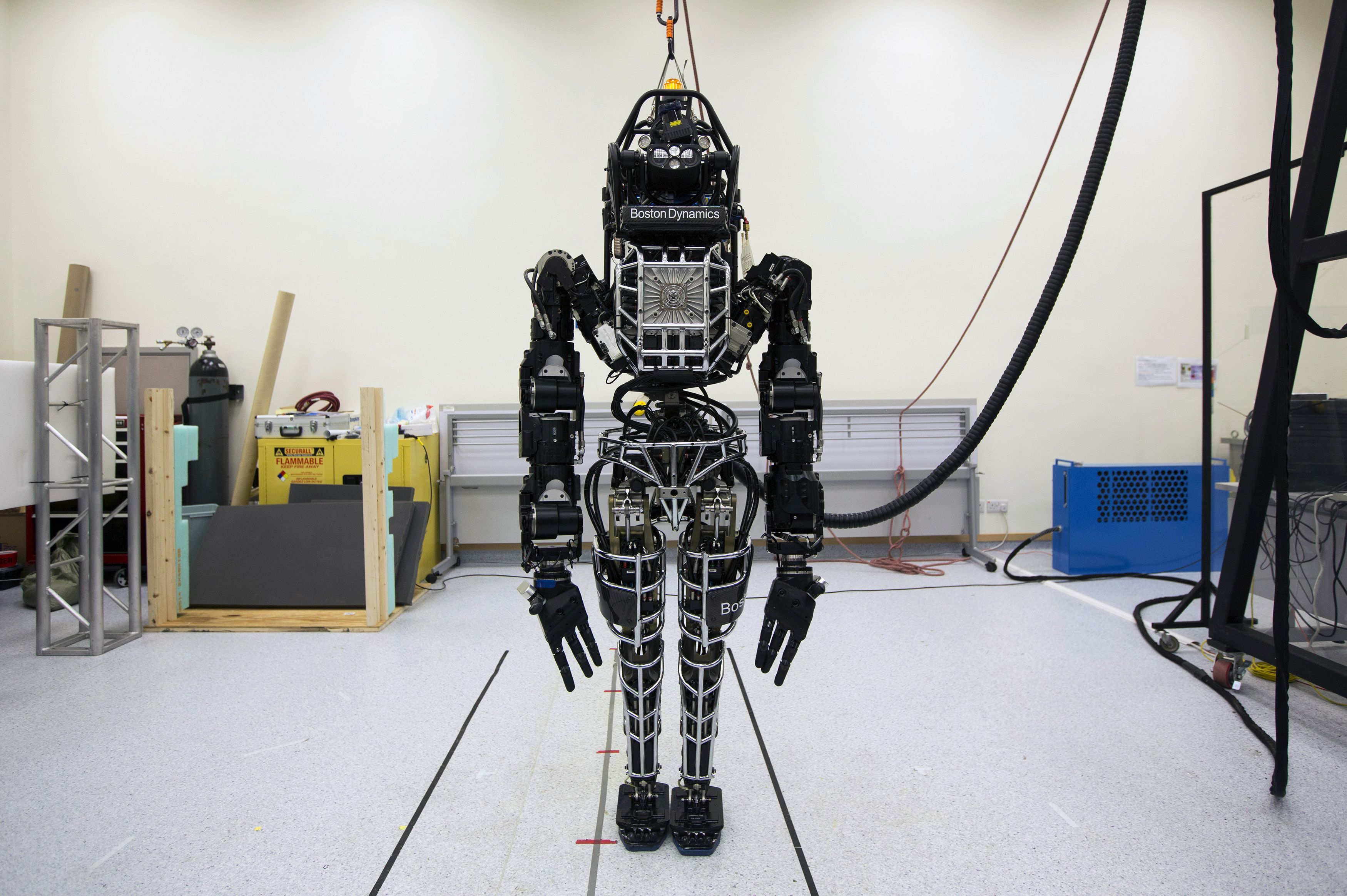 """Bipedal humanoid robot """"Atlas"""", primarily developed by the American robotics company Boston Dynamics, is presented to the media during a news conference at the University of Hong Kong October 17, 2013. The 6-foot (1.83 m) tall, 330-pound (149.7 kg) robot is made of graded aluminium and titanium and costs HK$ 15 million ($1.93 million). It is capable of a variety of natural movements, including dynamic walking, calisthenics and user programmed behaviours, according to the University of Hong Kong's press release. REUTERS/Tyrone Siu (CHINA - Tags: SCIENCE TECHNOLOGY) - RTX14EEC"""