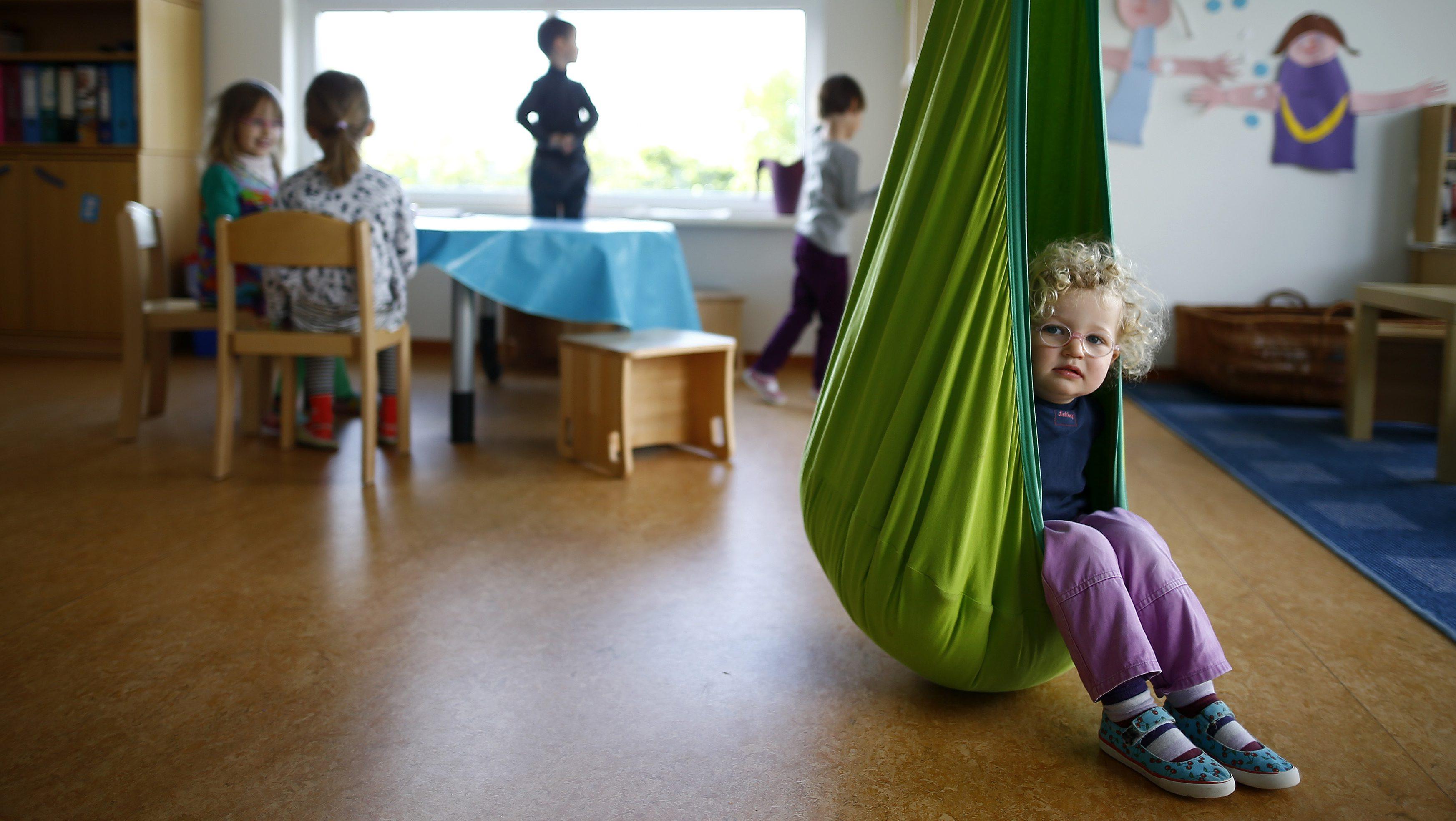 Children play in their kindergarten