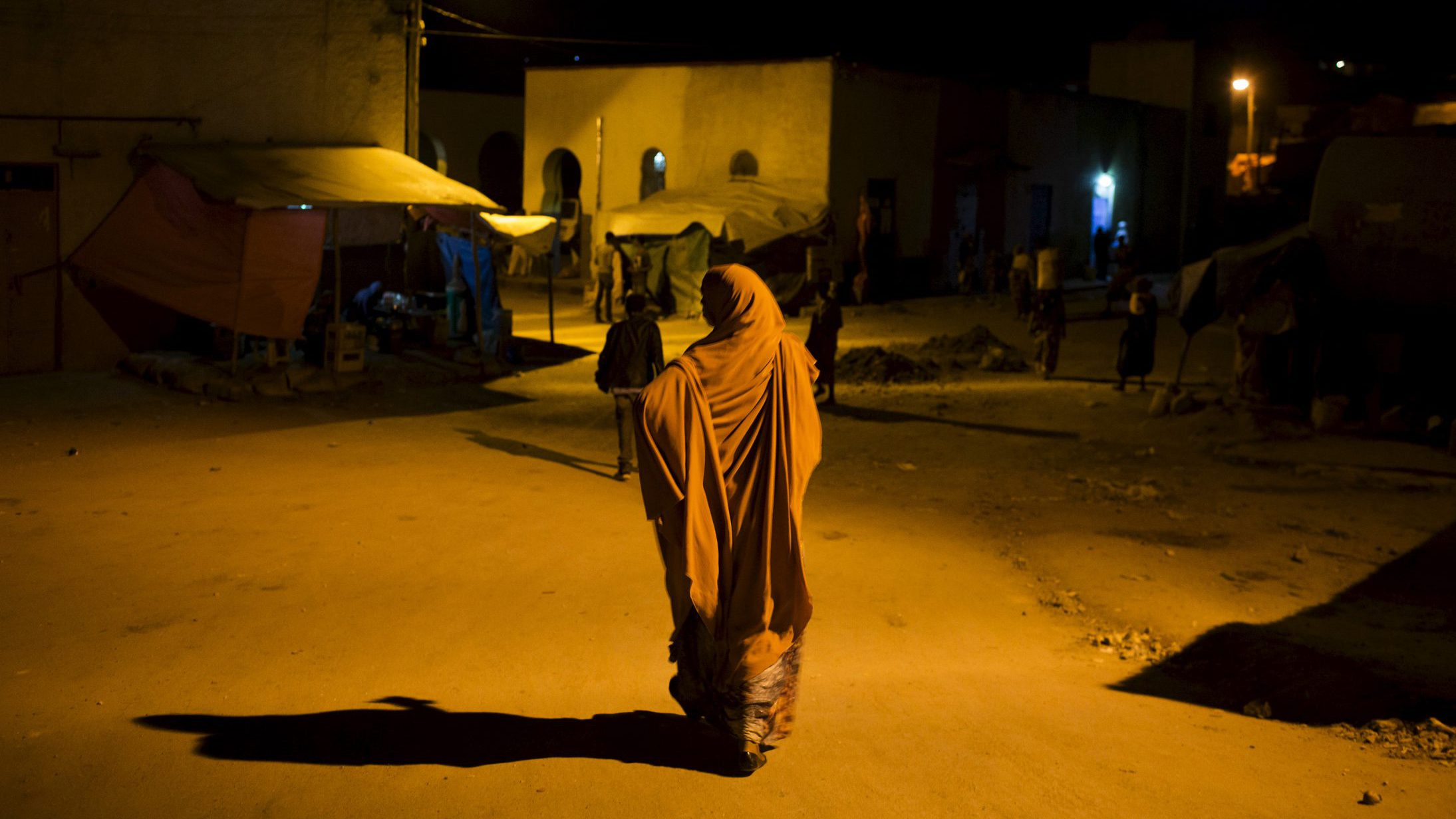 A woman walks in the old walled town of Harar in eastern Ethiopia, May 20, 2015.