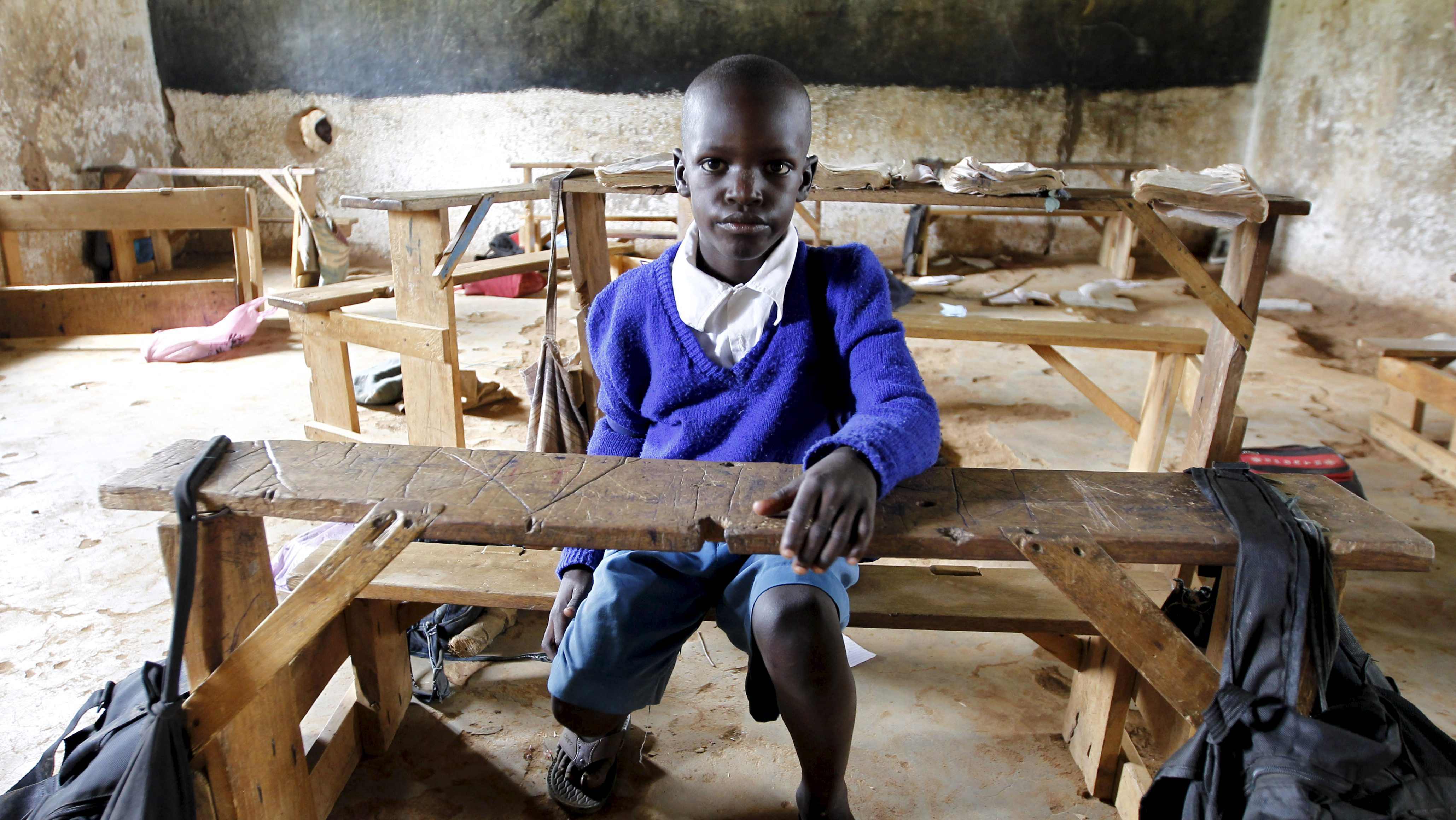 Seven-year-old Barack Obama Okoth, named after U.S. President Barack Obama, sits inside an empty classroom as he speaks with Reuters at the Senator Obama primary school in Nyangoma village in Kogelo ,west of Kenya's capital Nairobi, June 23, 2015.  When Barack Obama visits Africa this month, he will be welcomed by a continent that had expected closer attention from a man they claim as their son, a sentiment felt acutely in the Kenyan village where the 44th U.S. president's father is buried. Picture taken June 23, 2015.