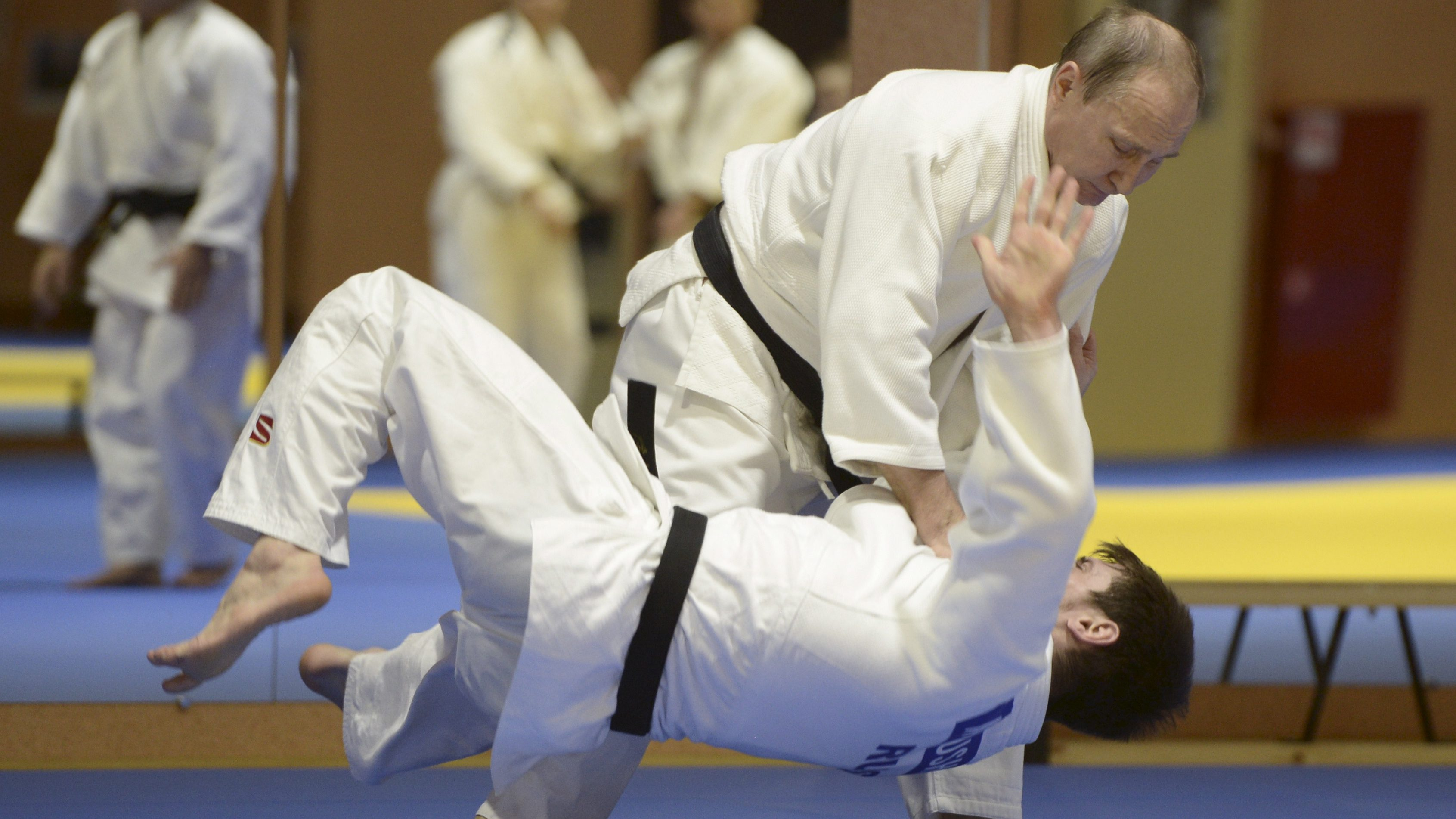 Russia's President Vladimir Putin practises with Musa Mogushkov of Russian national judo team during a training session in Sochi, Russia, January 8, 2016. REUTERS/Alexey Nikolsky/Sputnik/Kremlin ATTENTION EDITORS - THIS IMAGE HAS BEEN SUPPLIED BY A THIRD PARTY. IT IS DISTRIBUTED, EXACTLY AS RECEIVED BY REUTERS, AS A SERVICE TO CLIENTS.      TPX IMAGES OF THE DAY      - RTX21K4K