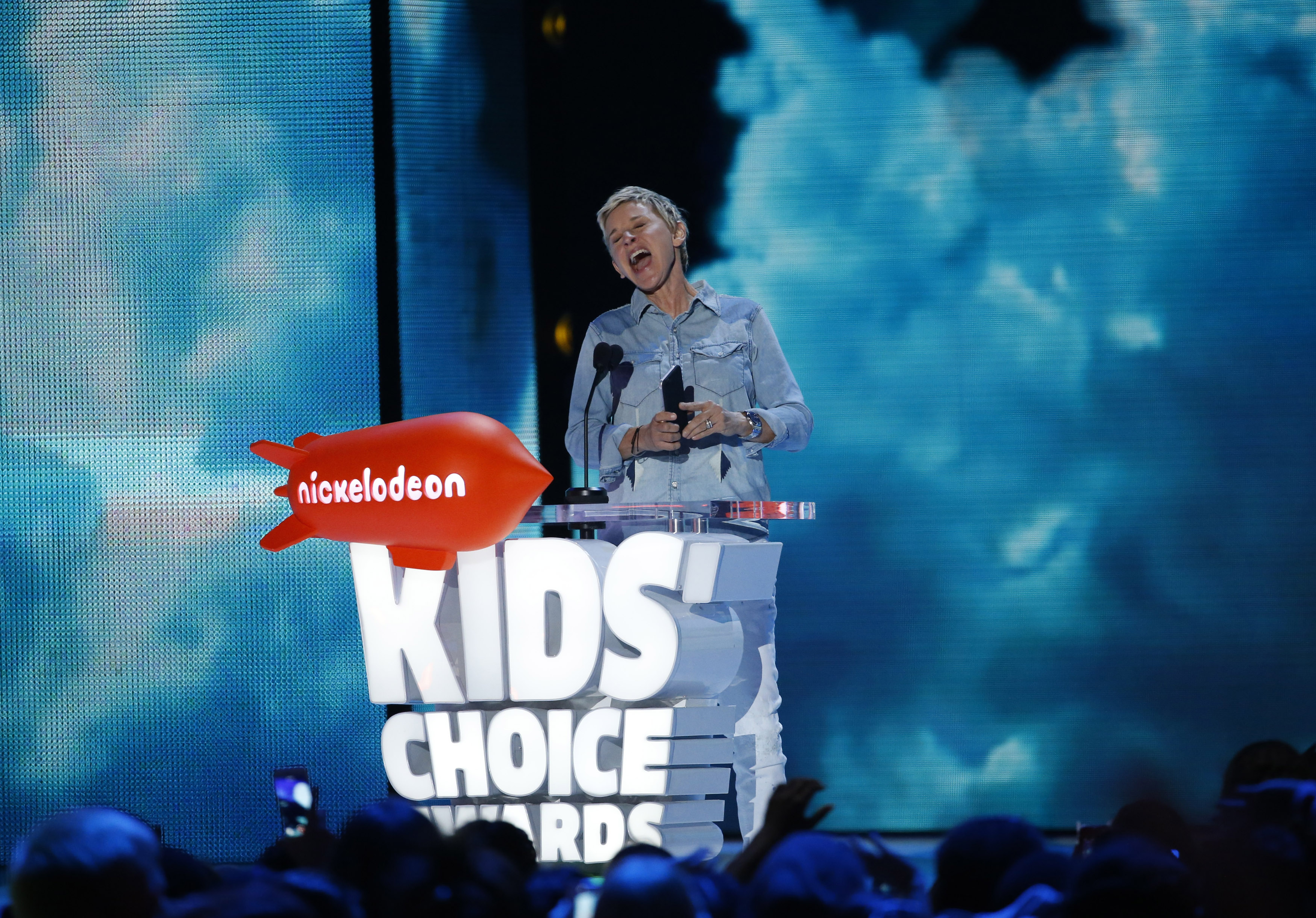 Television host Ellen DeGeneres presents the award for Favorite Animated Movie at Nickelodeon's 2016 Kids' Choice Awards in Inglewood, California March 12, 2016.