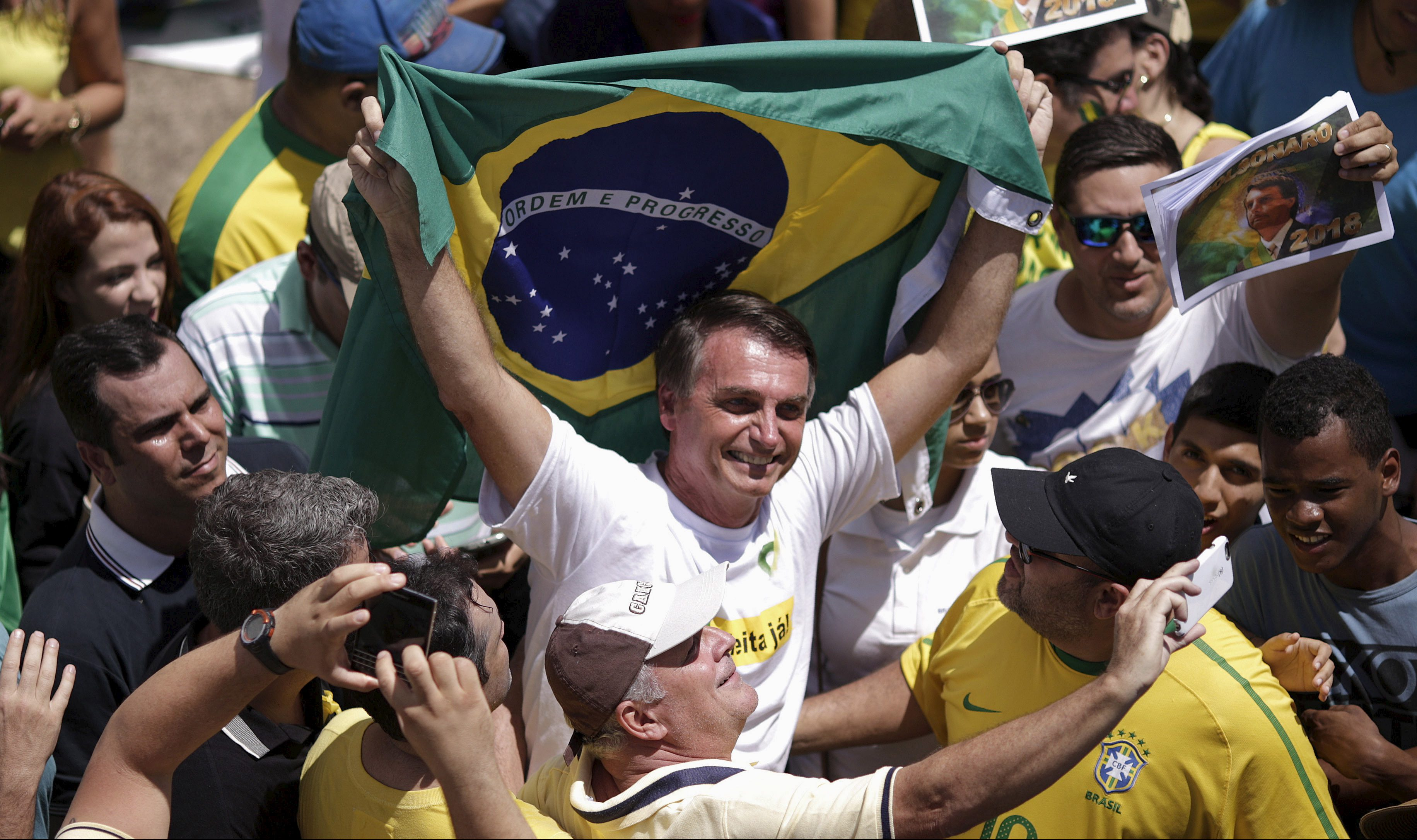 Congressman Jair Bolsonaro holds a Brazilian flag during a protest against Brazil's President Dilma Rousseff, part of nationwide protests calling for her impeachment, in Brasilia, Brazil, March 13, 2016. REUTERS/Ueslei Marcelino - RTX28Z8C
