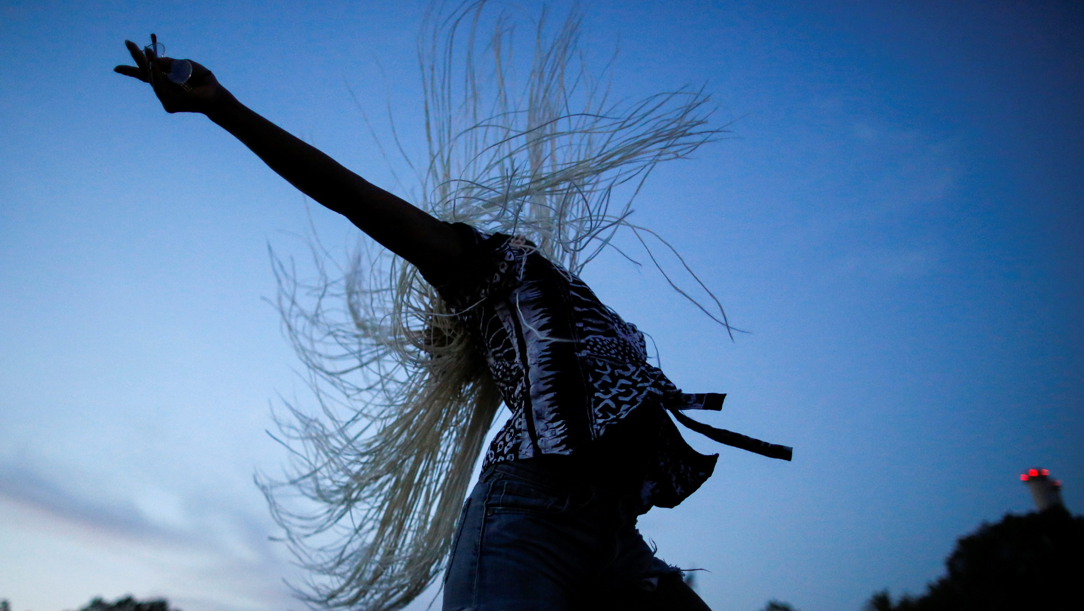 A woman dances as she takes part in the Annual Afropunk Music festival in the borough of Brooklyn in New York