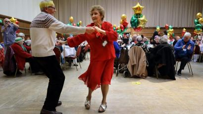 Pensioners dancing at an event