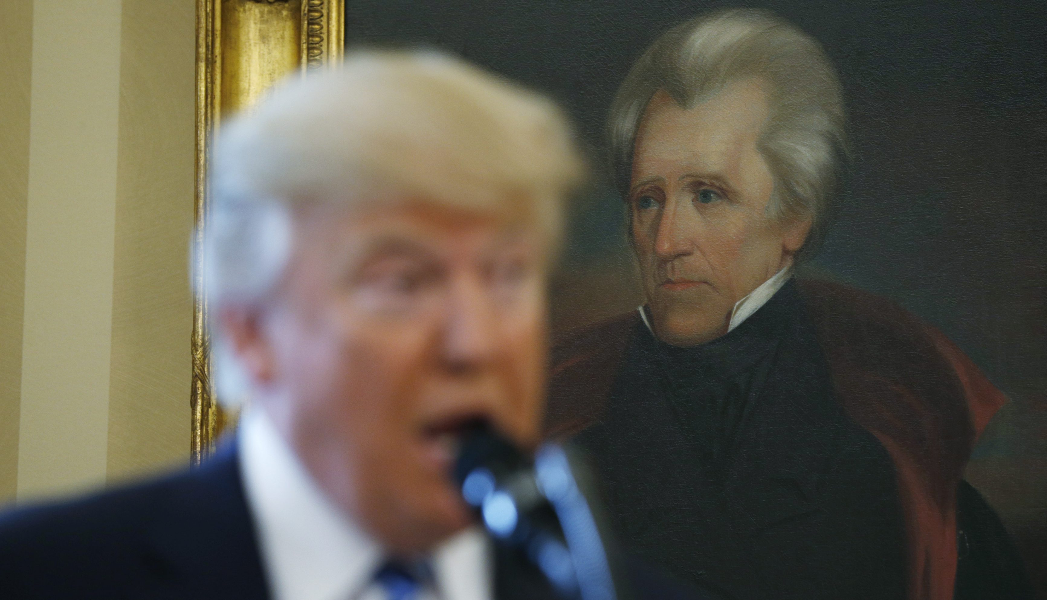 U.S. President Donald Trump speaks in front of a portrait of former U.S. President Andrew Jackson during a swearing-in ceremony for new Attorney General Jeff Sessions at the White House in Washington, U.S., February 9, 2017.