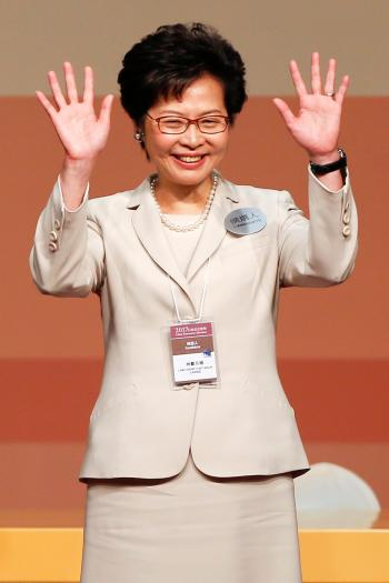 Carrie Lam waves after she won the election for Hong Kong's Chief Executive in Hong Kong, China March 26, 2017.