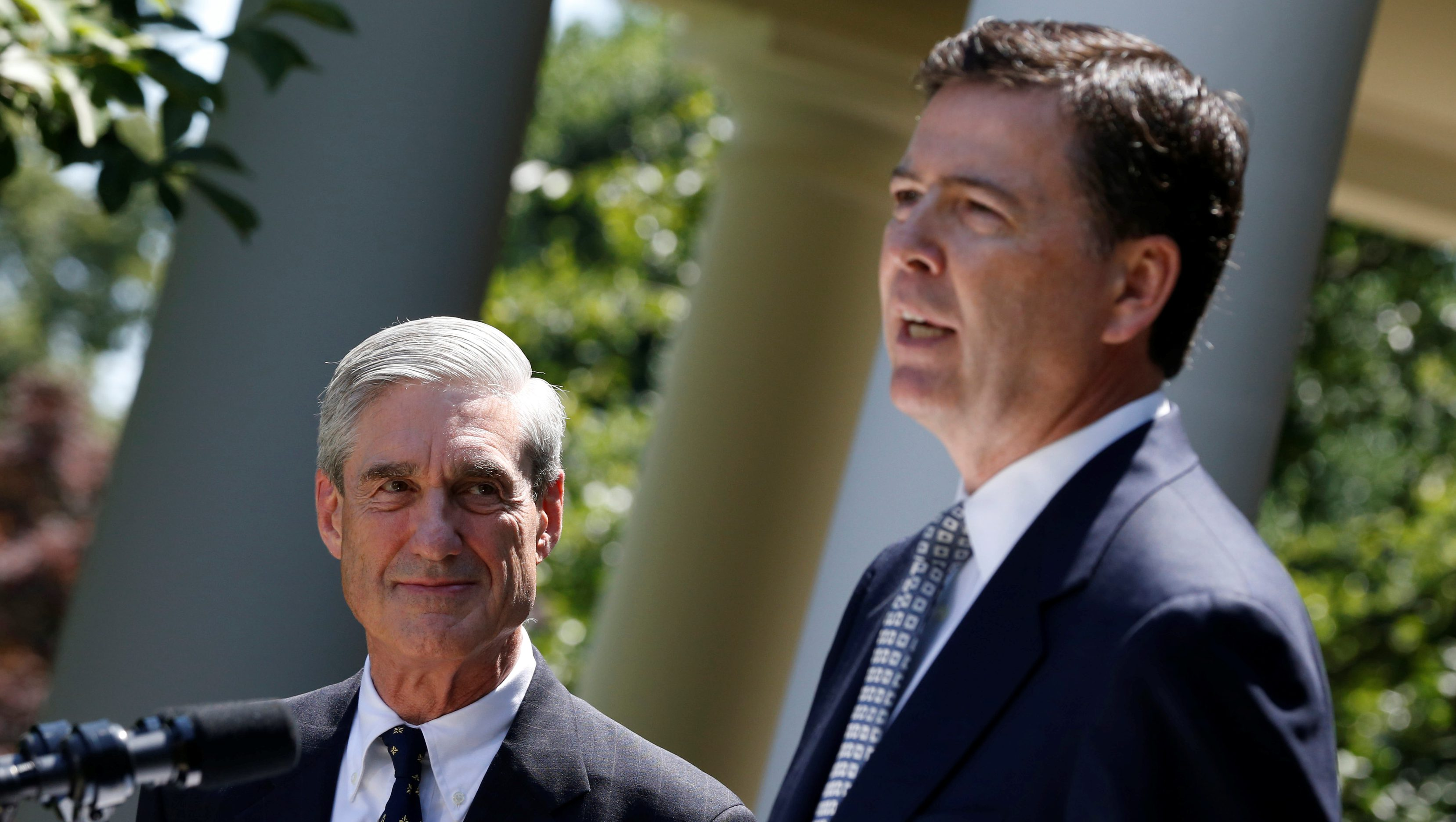 FILE PHOTO: James Comey speaks alongside outgoing FBI Director Robert Mueller at the White House in Washington