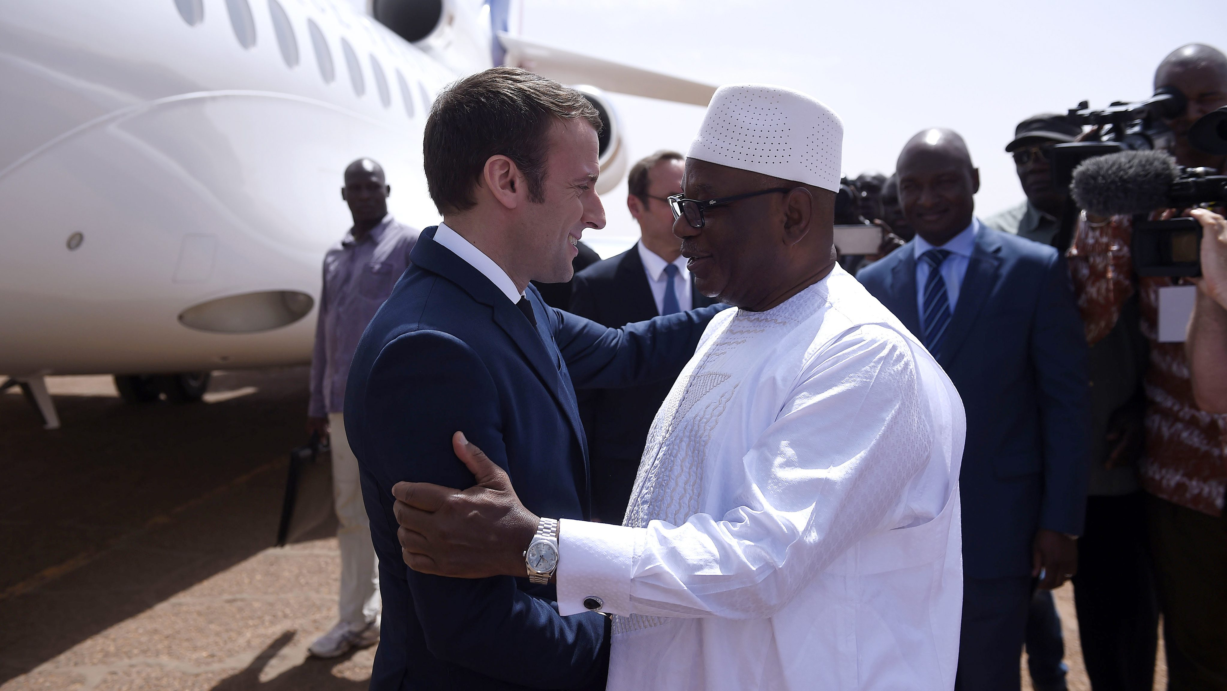 French President Emmanuel Macron with Mali's President Ibrahim Boubacar Keita as he visits French troops in Africa's Sahel region in Mali