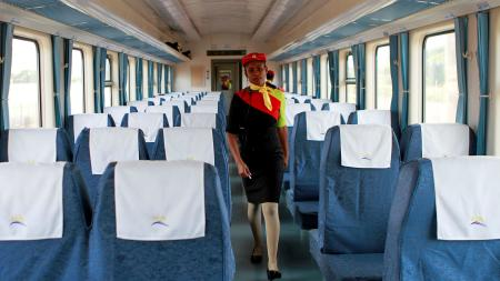 A train attendant walks inside one of the new coaches of the Standard Gauge Railway in Mombasa.