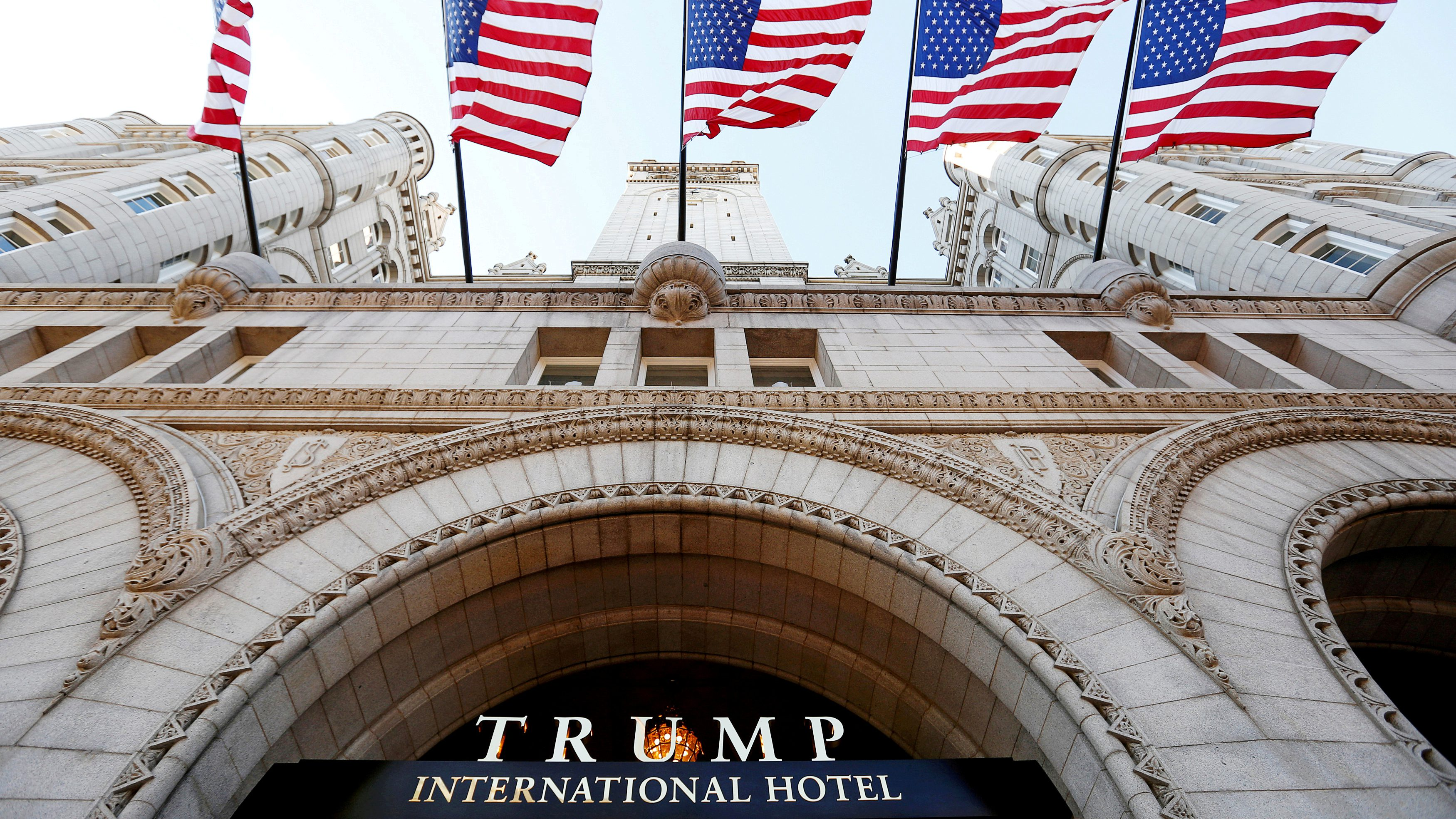 FILE PHOTO - Flags fly above the entrance to the new Trump International Hotel on its opening day in Washington, DC, U.S. on September 12, 2016. REUTERS/Kevin Lamarque/File Photo - RTX38E6D