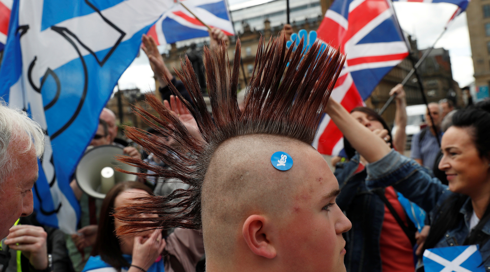 Demonstrators wave flags at a march in support of Scottish independence, in Glasgow, Scotland, Britain June 3, 2017. REUTERS/Russell Cheyne - RTX38TK0