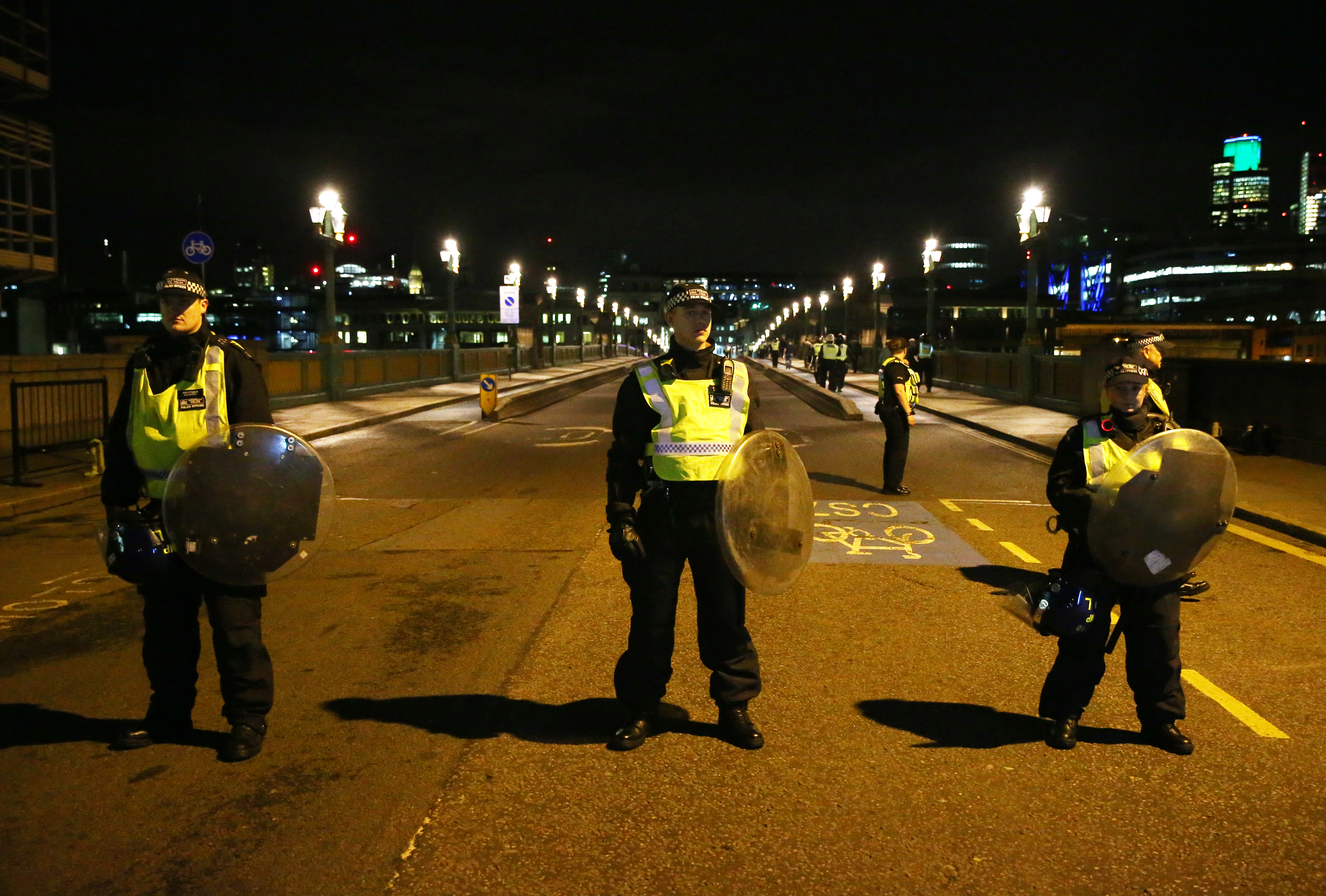 Police officers guard the approach to Southwark Bridge after an incident near London Bridge in London, Britain June 4, 2017.