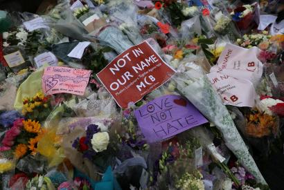 Floral tributes lie on the ground after the terrorist attack on London Bridge
