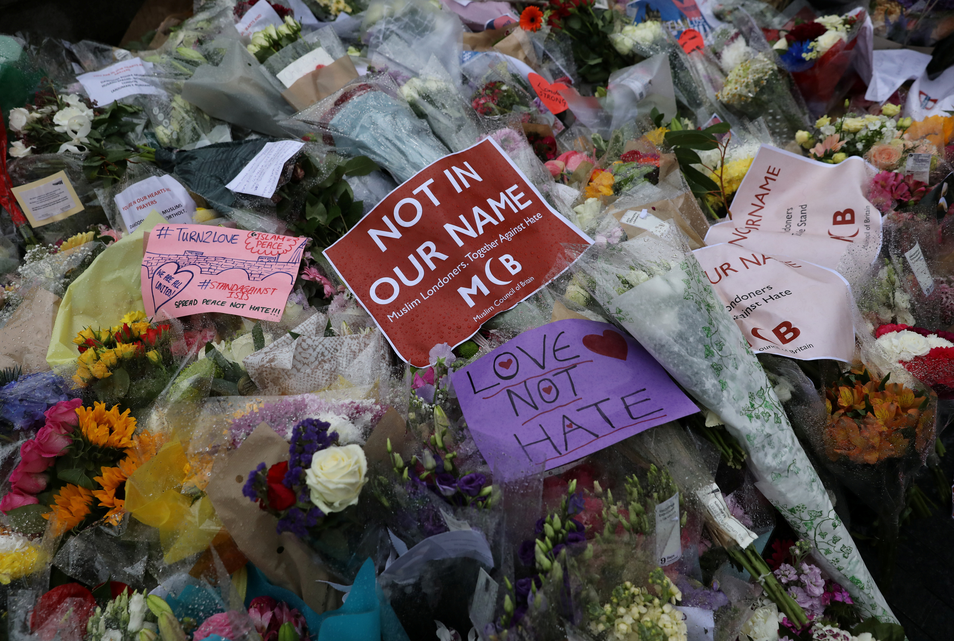 Floral tributes lie on the ground after a vigil to remember the victims of the attack on London Bridge and Borough Market, at Potters Field Park, in central London, Britain, June 5, 2017.