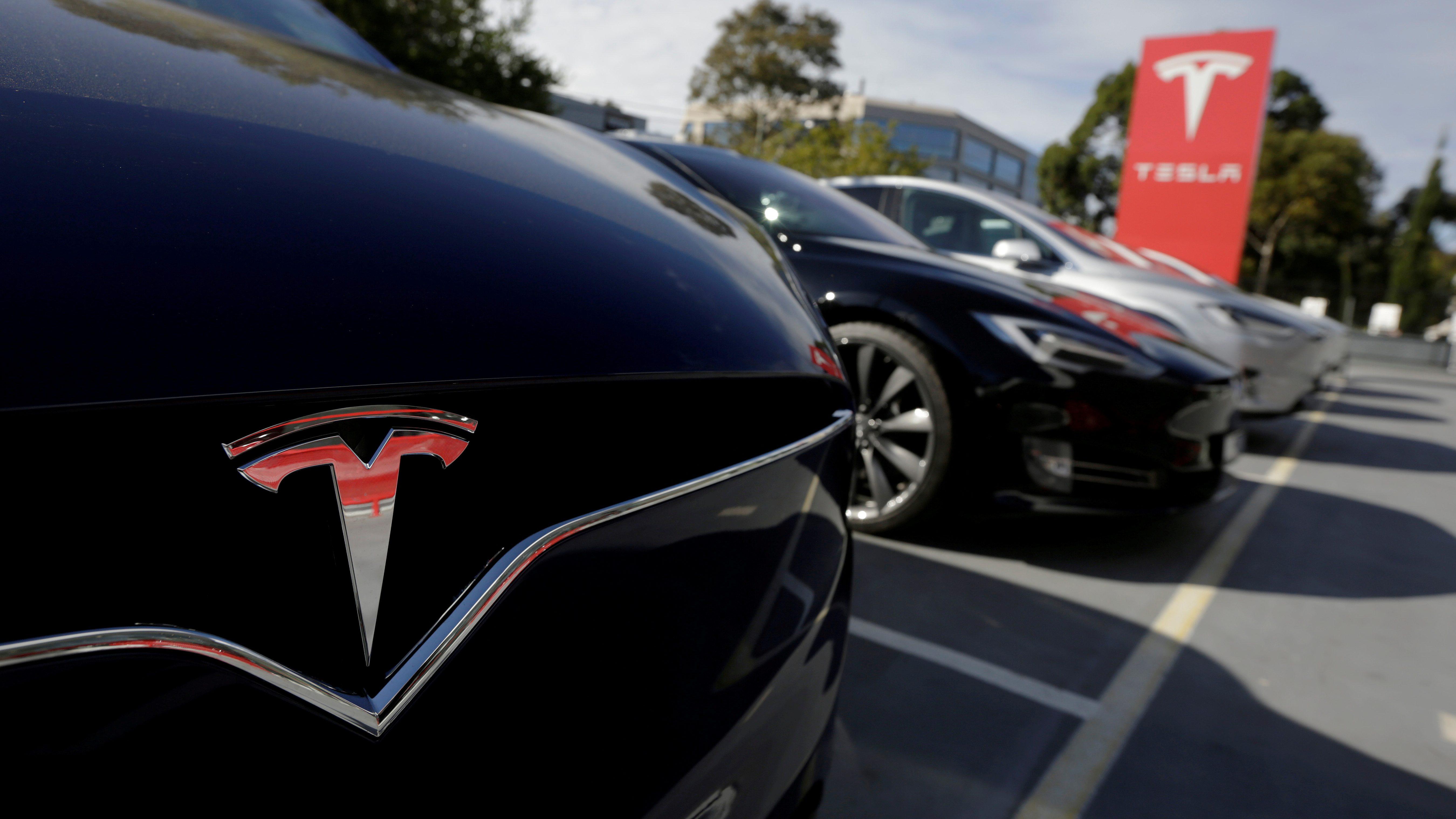 A Tesla Model X is photographed alongside a Model S at a Tesla electric car dealership in Sydney