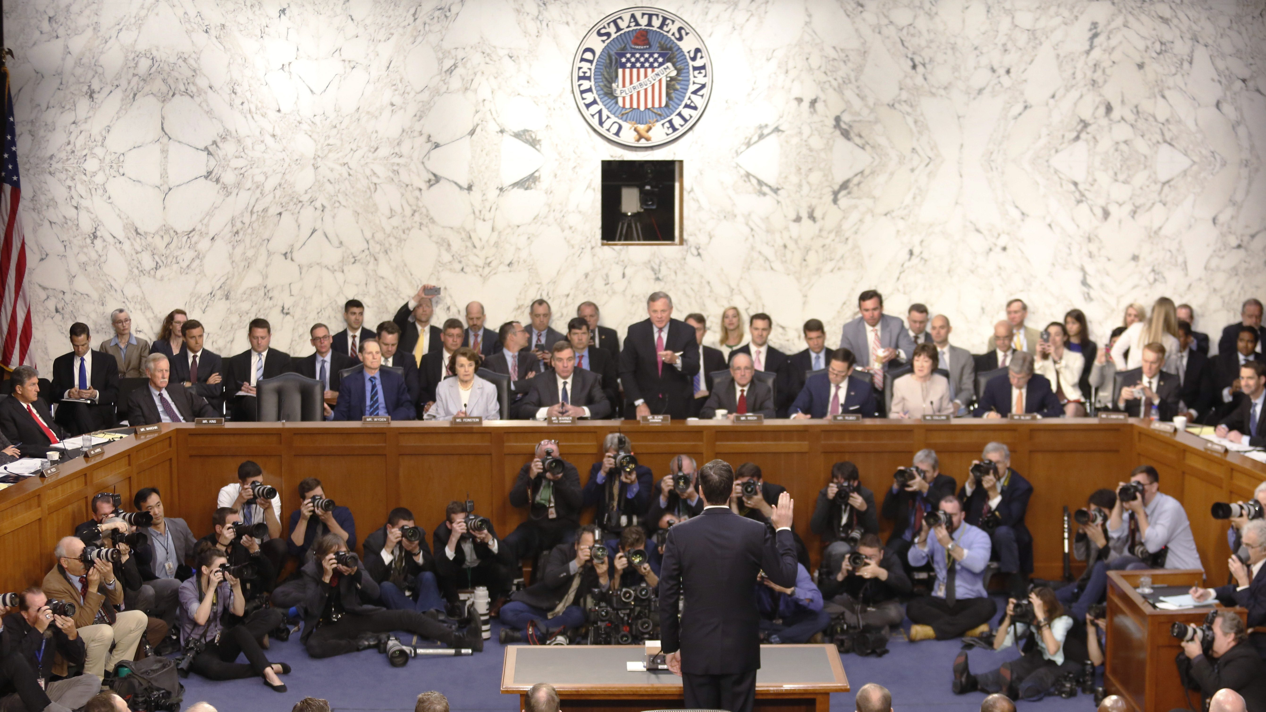 """Former FBI Director James Comey is sworn in to testify before a Senate Intelligence Committee hearing on """"Russian Federation Efforts to Interfere in the 2016 U.S. Elections"""" on Capitol Hill in Washington, U.S. June 8, 2017. REUTERS/Jim Bourg - RTX39OPY"""
