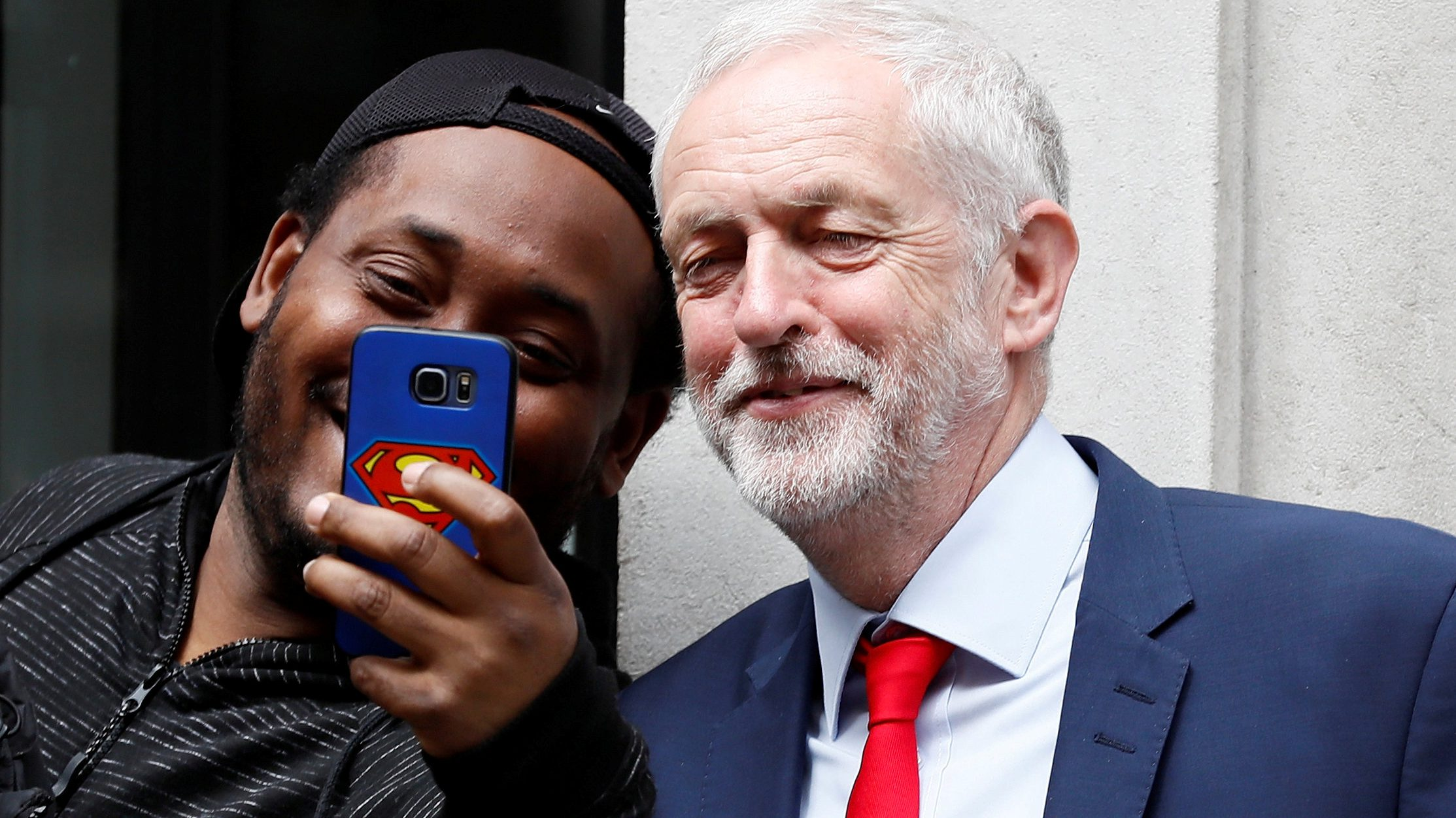 Jeremy Corbyn, the leader of Britain's opposition Labour Party, poses for a selfie as he leaves BBC radio studios in London