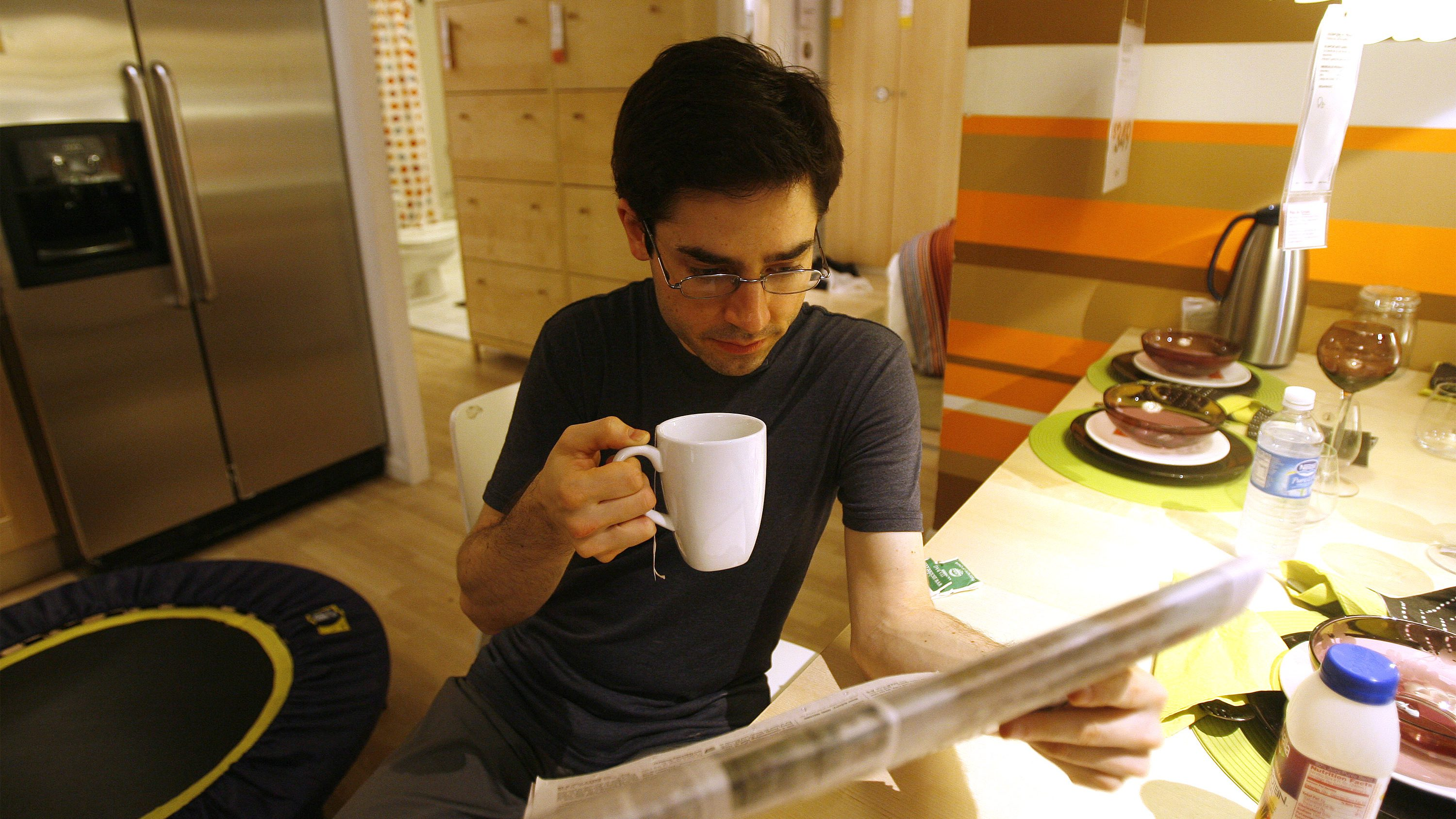 "Mark Malkoff, 31, drinks tea and reads a newspaper inside an IKEA store in Paramus, New Jersey January 8, 2008. When furniture retailer IKEA promoted its latest U.S. sale by asking customers on its Web site if they are ""ready to take advantage of us,"" one customer took them up on the offer in a novel way. Malkoff moved into the IKEA store in Elizabeth, New Jersey, for a week while his New York City apartment is fumigated because his friends' apartments were too small to accommodate him and hotels were too expensive."
