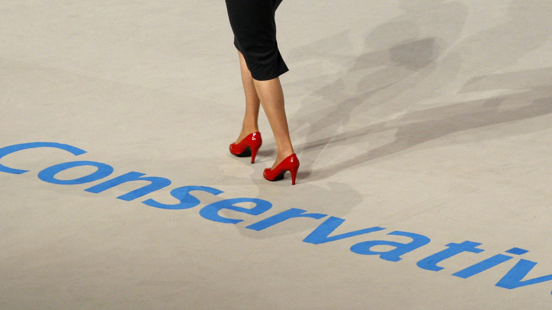 Britain's Shadow Minister for Women, Theresa May, walks across the stage to speak at the Conservative Party annual conference at the International Convention Centre in Birmingham, central England September 30, 2008.   REUTERS/Stephen Hird   (BRITAIN) - RTX92WH