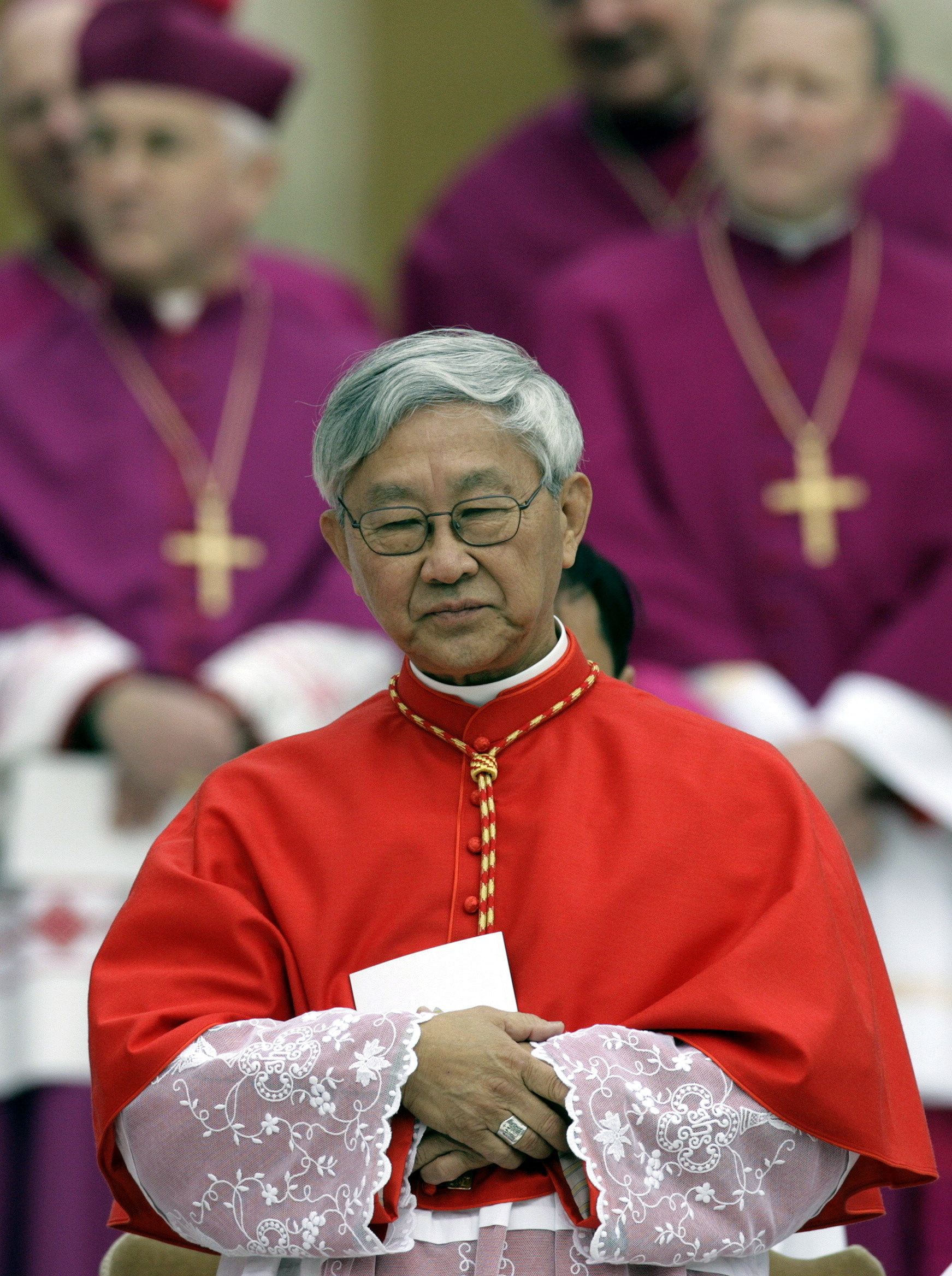 Hong Kong's Bishop Joseph Zen Ze-kiun attends a ceremony to be elevated to cardinal by [Pope Benedict XVI] at the Vatican March 24, 2006. Pope Benedict installs his first group of new cardinals on Friday, elevating a familiar face and some surprising choices to the exclusive Roman Catholic club that advises him and will one day elect his successor.