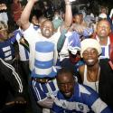 Kenyan soccer fans from the AFC Leopards football club sing after a stampede at the Nyayo National Stadium in Nairobi October 23, 2010. Seven soccer fans were killed and dozens more were injured in a stampede at a match between two of Kenya's top teams, AFC Leopards and Gor Mahia, an ambulance operator said on Saturday.