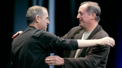 Apple CEO Steve Jobs hugs Intel President and CEO Paul Otellini at the Apple Worldwide Developer ...