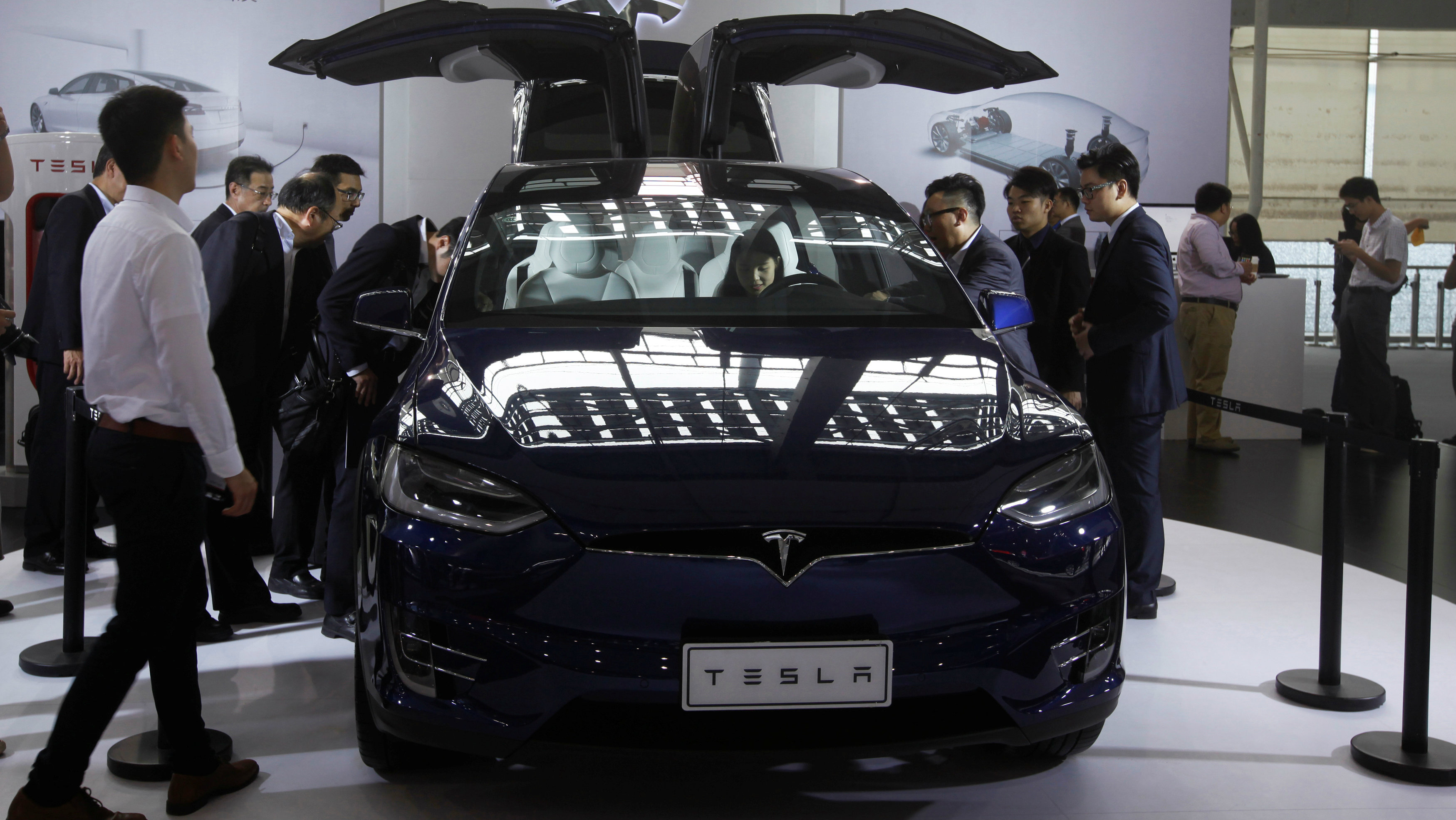 Visitors surround a Tesla Model X at China (Guangzhou) International Automobile Exhibition in Guangzhou, China November 18, 2016.