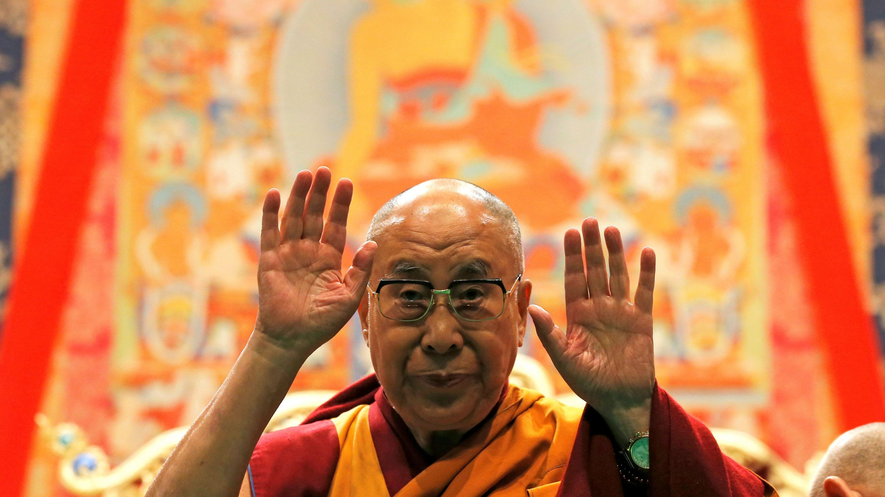 Tibet's exiled spiritual leader the Dalai Lama gestures as he arrives to give a public religious lecture to the faithful in Strasbourg, France, September 17, 2016.