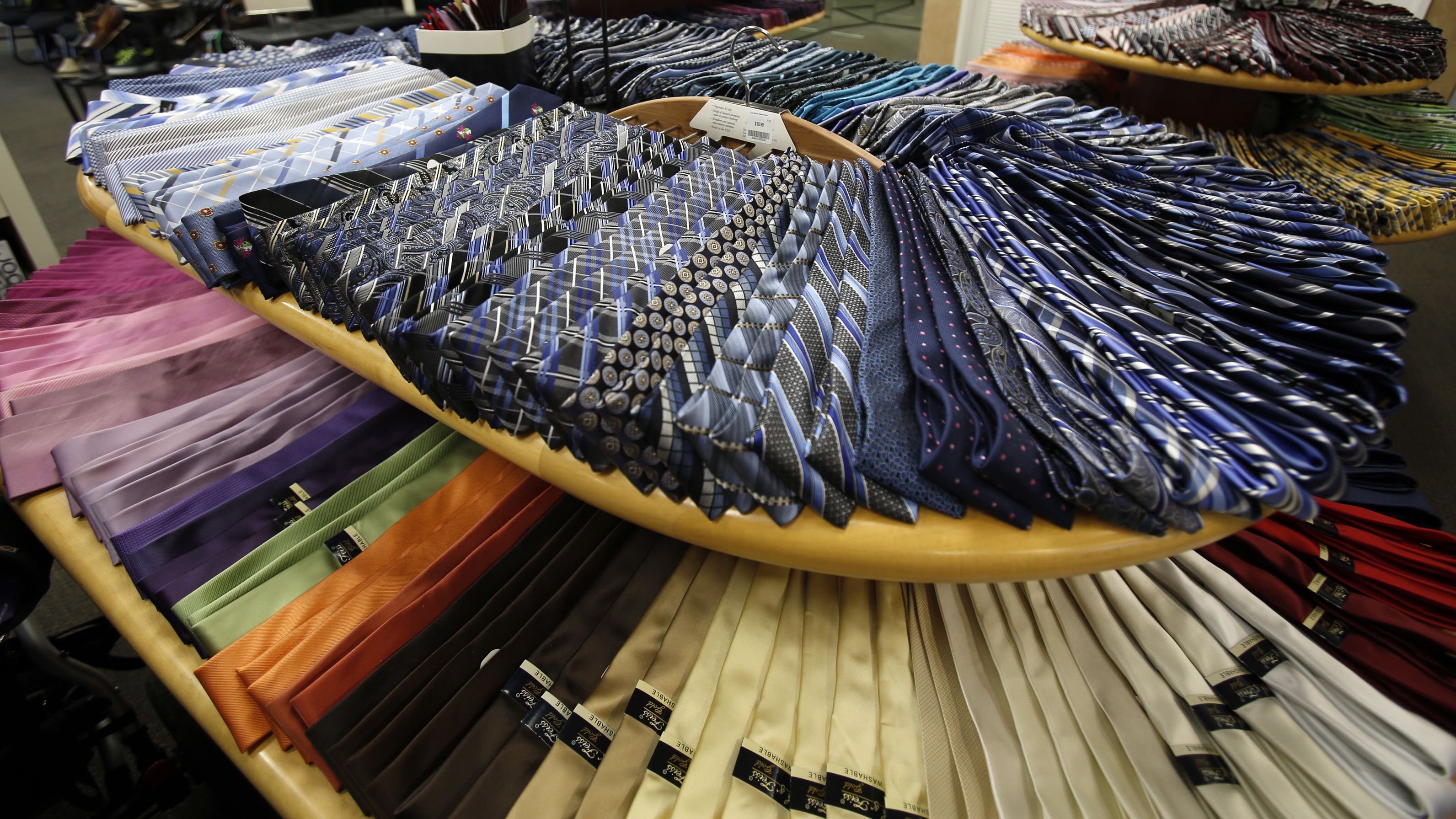 Ties are pictured at a Men's Wearhouse store in Pasadena, California June 25, 2013. Men's Wearhouse Inc said it fired founder and Executive Chairman George Zimmer after he pushed to take the company private and effectively demanded to be reinstated as the sole decision maker at the clothing chain. REUTERS/Mario Anzuoni (UNITED STATES - Tags: BUSINESS TEXTILE EMPLOYMENT)
