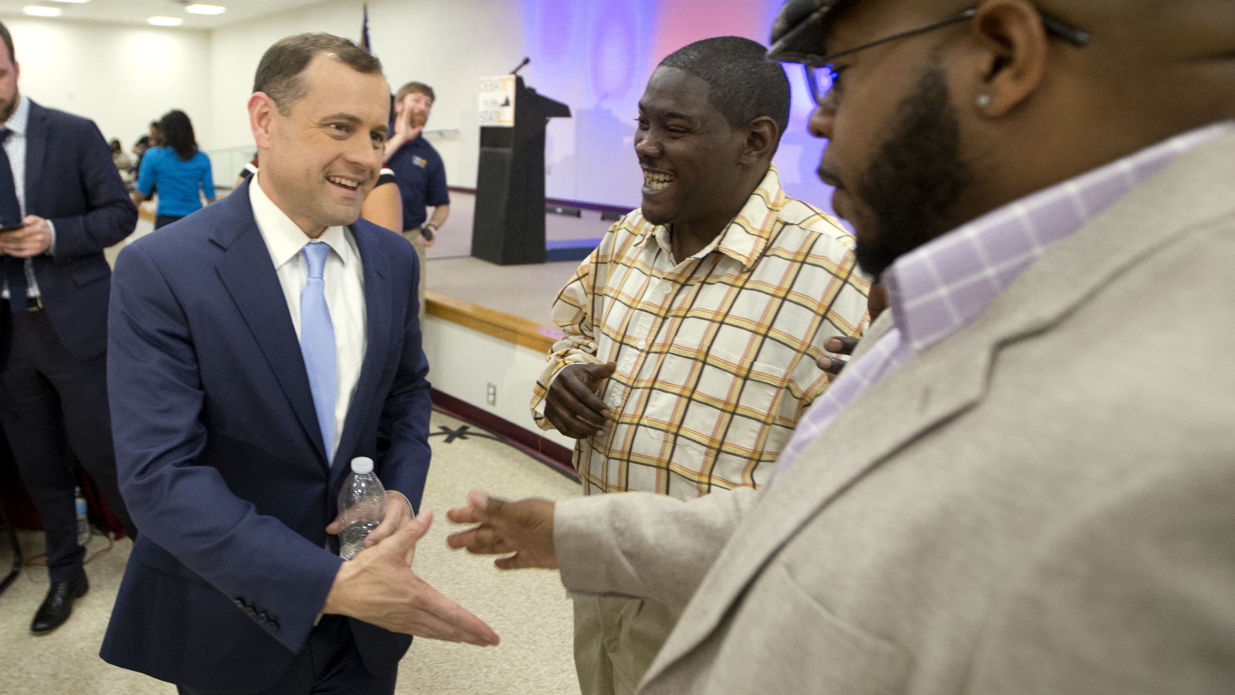 Democratic Gubernatorial candidate former Congressman Tom Perriello, left, greets supporters after a debate at a Union hall in Richmond, Va., Tuesday, May 9, 2017. The two candidates face off in the June 13th primary.