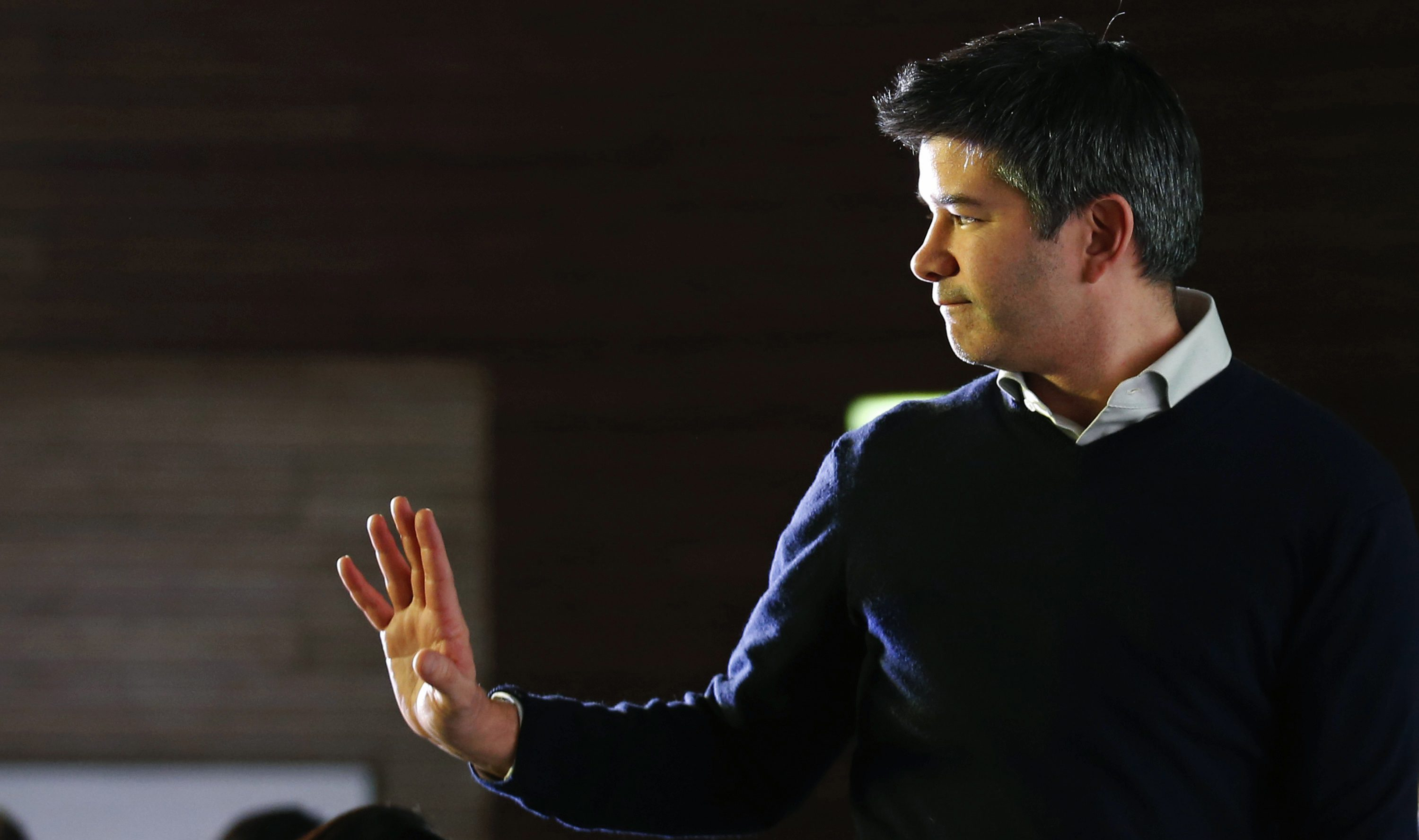 Uber CEO Travis Kalanick acknowledges attendees during the Baidu and Uber strategic cooperation and investment signing ceremony at Baidu's headquarters in Beijing December 17, 2014. Deep-pocketed Chinese rivals and tough regulators stand in the way of U.S. car-hailing service Uber's plans to conquer one of the world's biggest transportation markets, even after it signed a tieup with domestic internet giant Baidu Inc.  REUTERS/Kim Kyung-Hoon (CHINA - Tags: BUSINESS SCIENCE TECHNOLOGY TRANSPORT) - RTR4IC7F